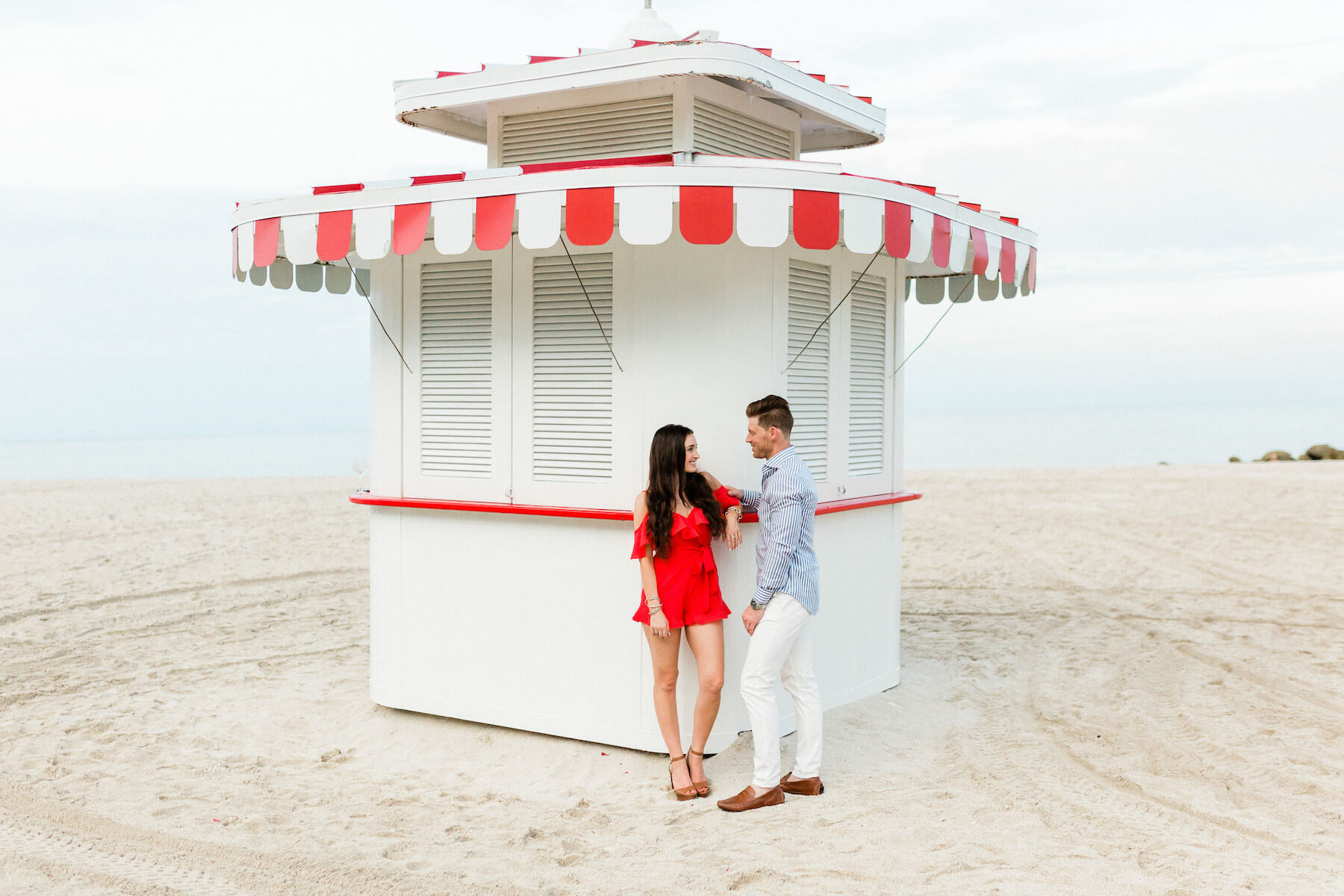 couple standing in front of concession stand on the beach in Miami, Florida