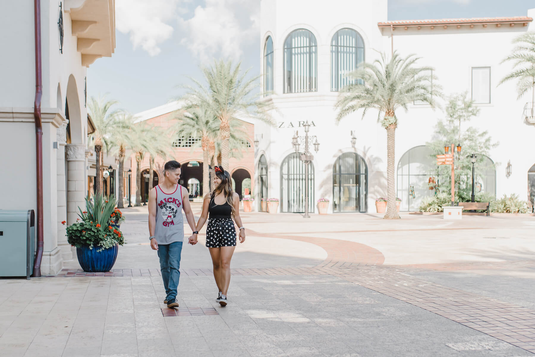 couple walking holding hands in Disney Orlando, Florida