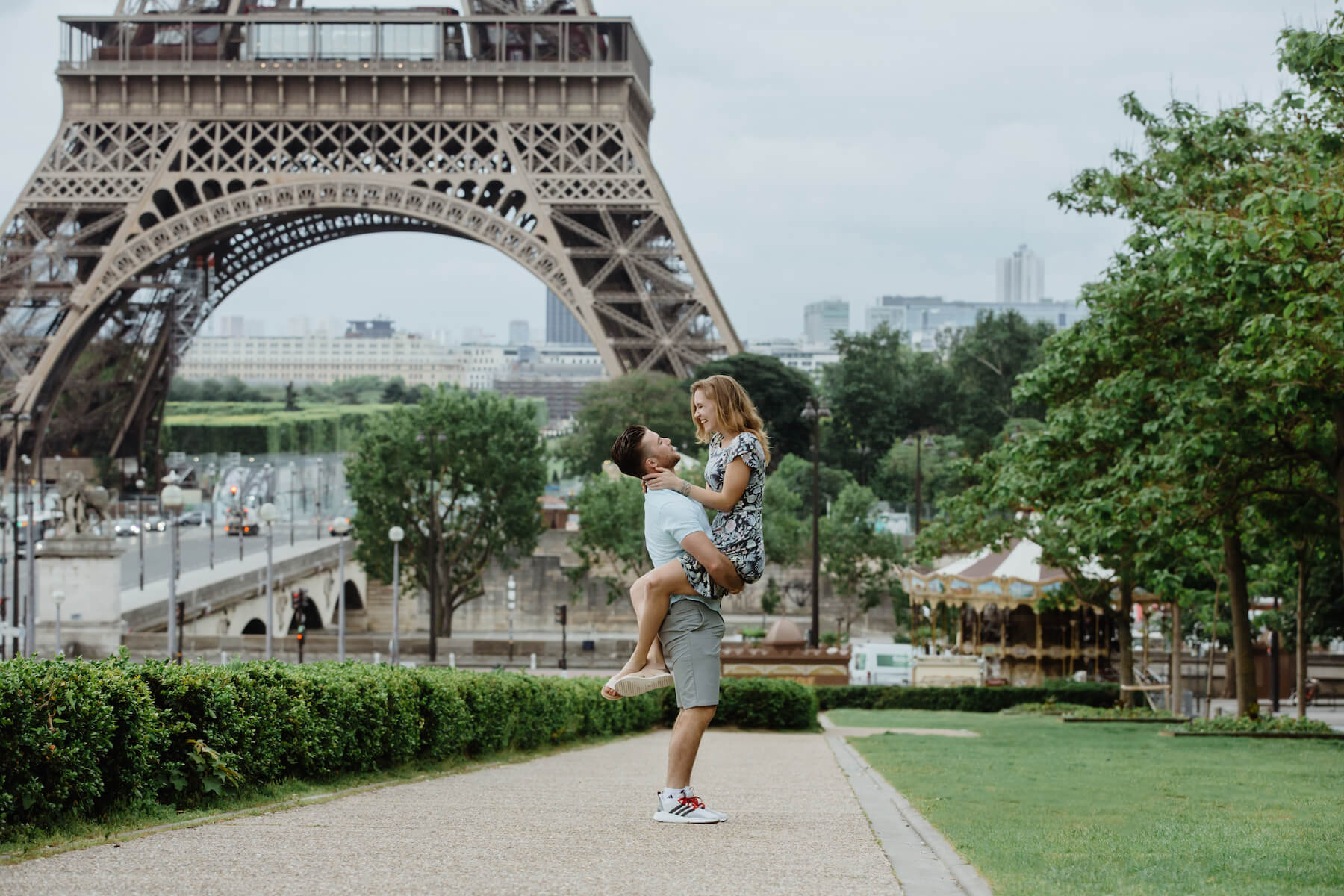 couple in front of the Eiffel Tower having fun in Paris, France
