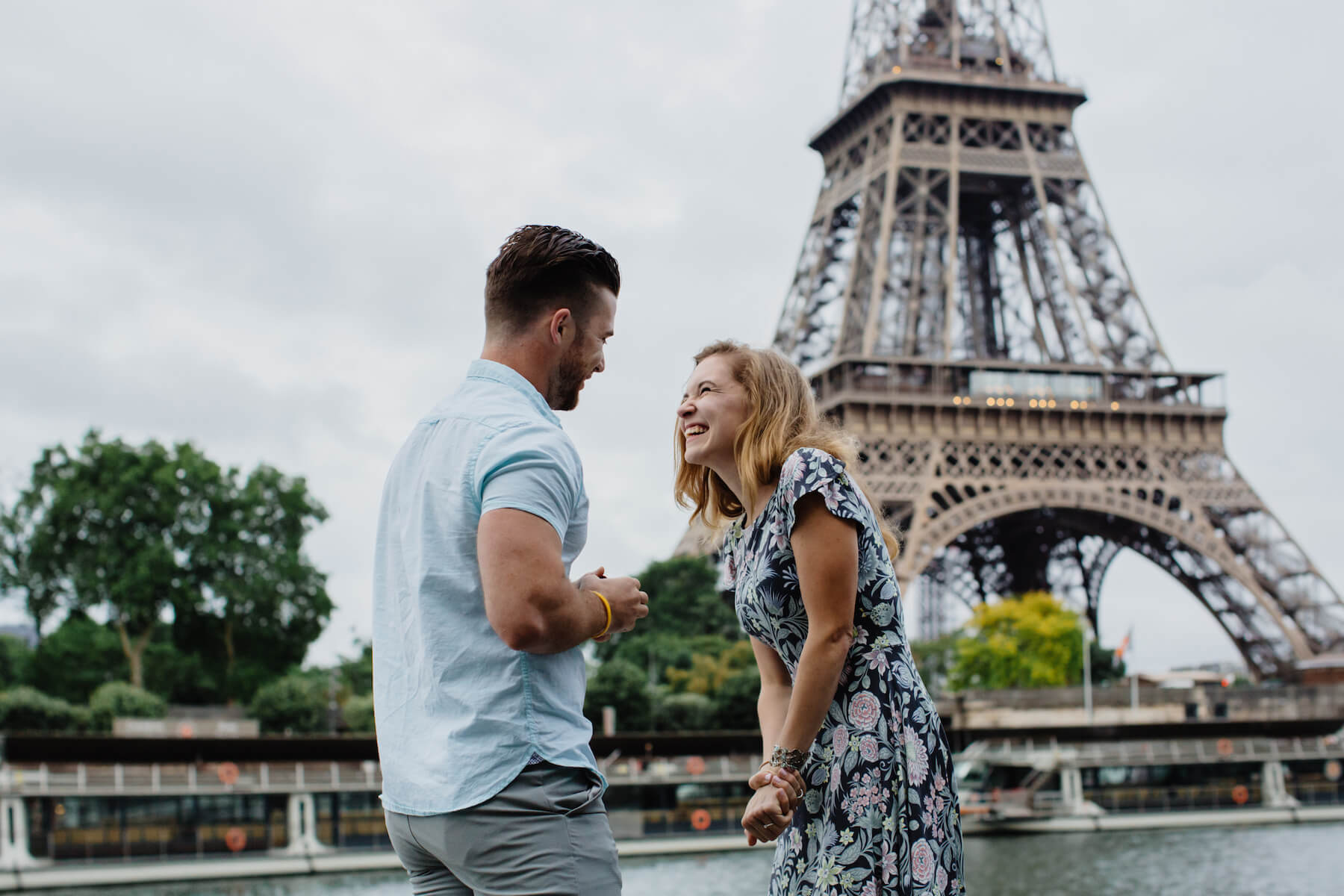 epic paris proposal, couple in front of the Eiffel Tower in Paris, France
