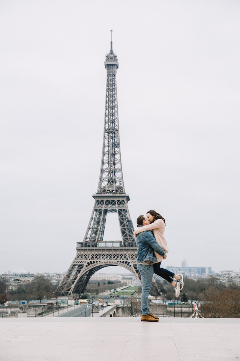 Couple hugging after a marriage proposal in Paris, France