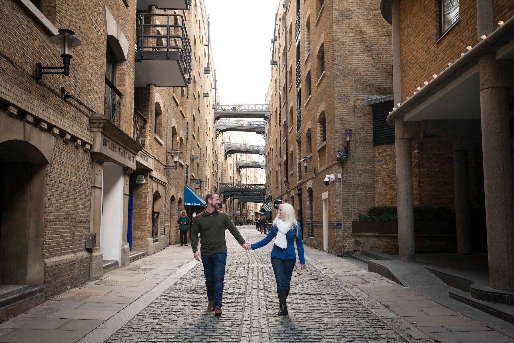 Couple holding hands and walking in London, England
