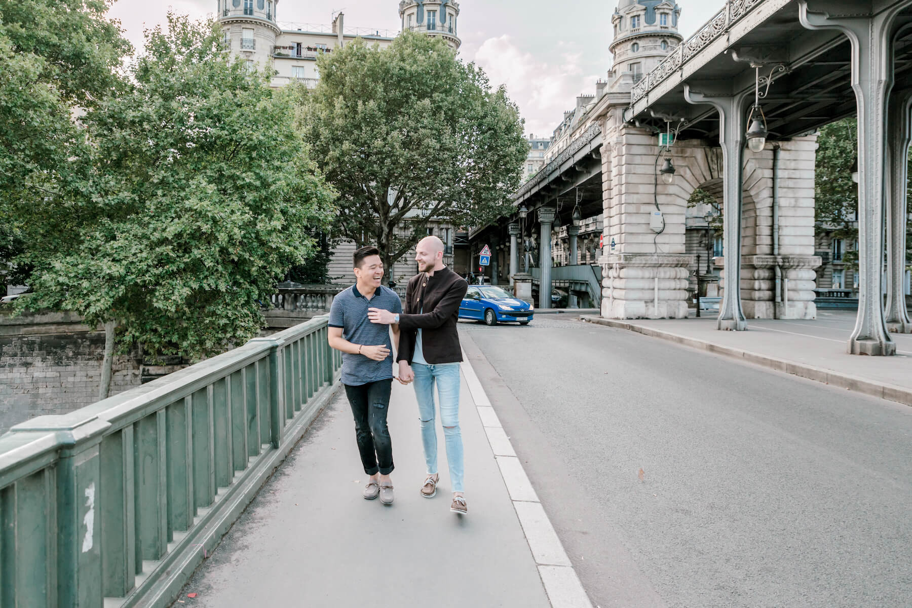 a couple walking near the Eiffel tower in Paris, France