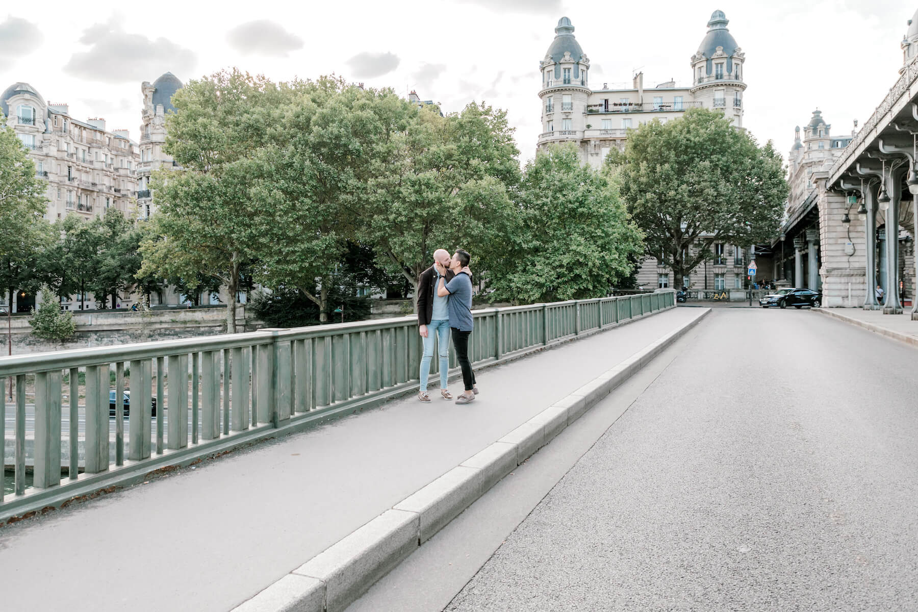 A couple kissing on the road near Eiffel tower in Paris, France