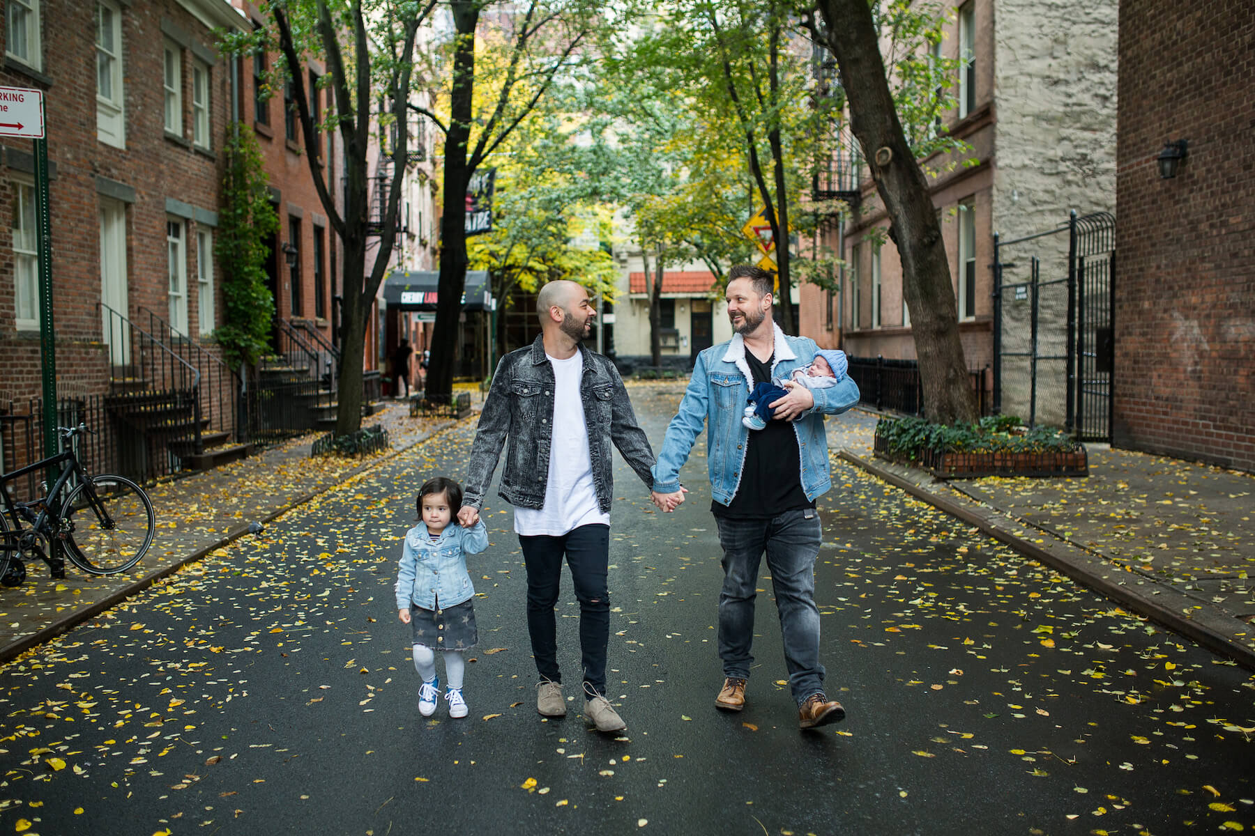 Family with a baby walking in New York City, New York