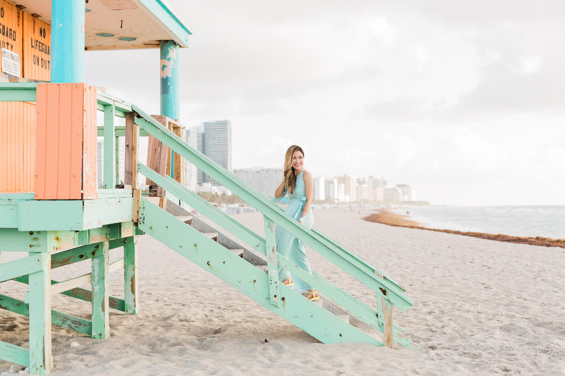 Solo traveller standing on a lifeguard station ramp on the beach in Miami, Florida