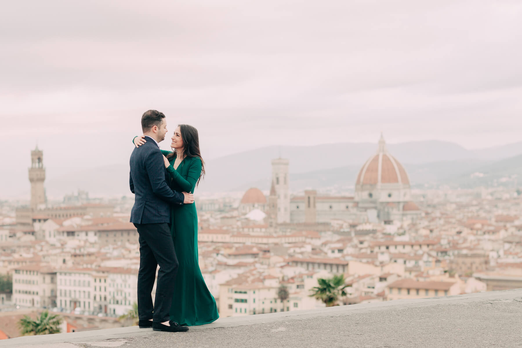 couple hugging with the city of Florence, Italy in the background