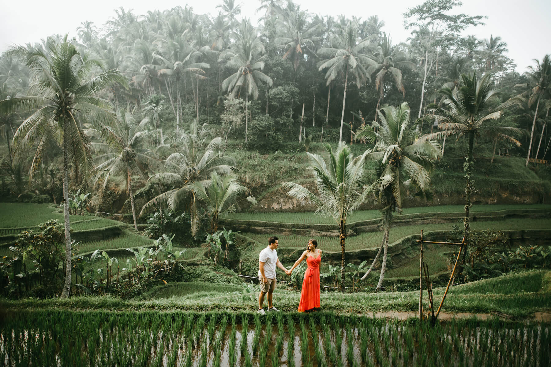 couple walking and holding hands in bali, Indonesia