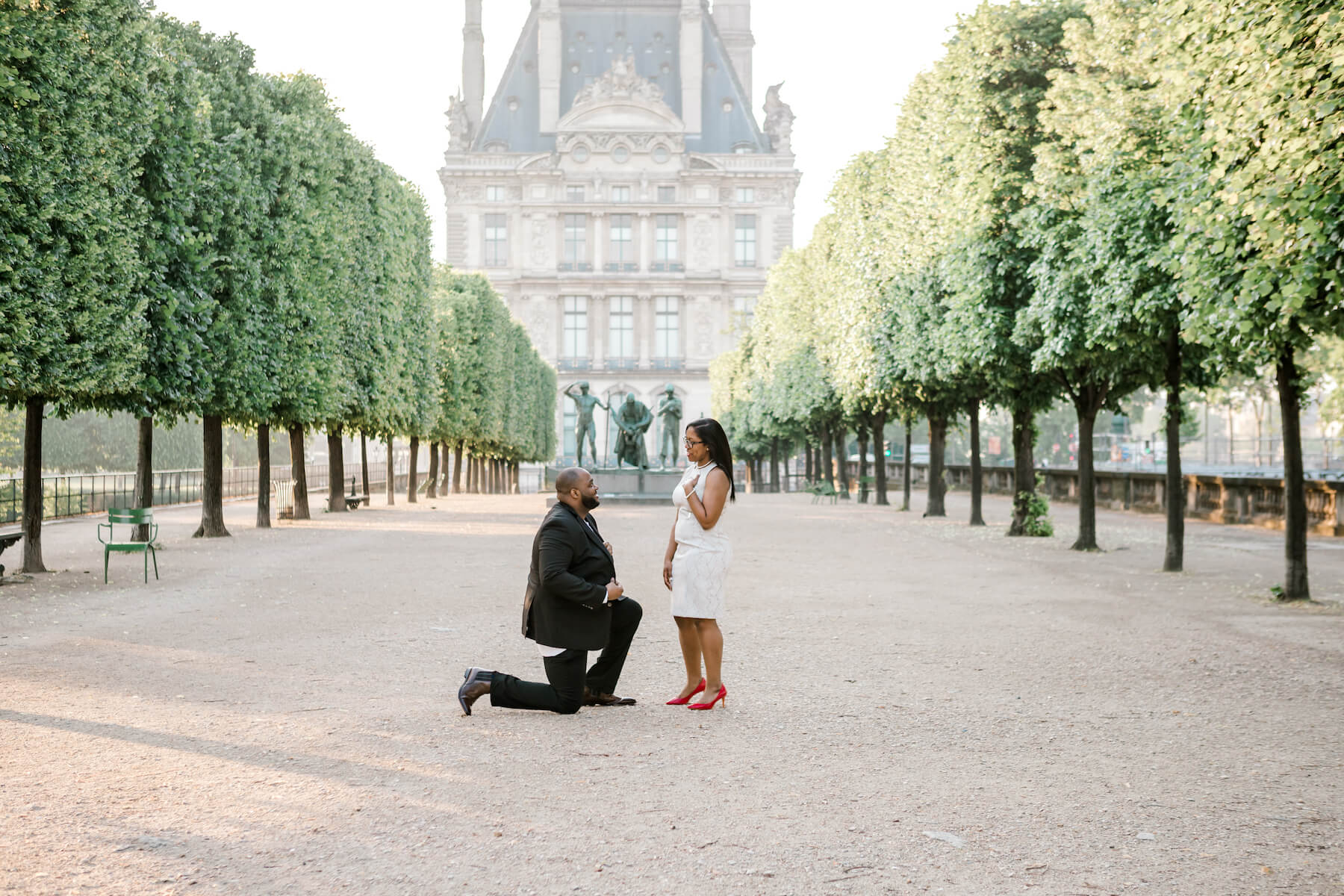 A man proposing on the Louvre grounds, in Paris, France