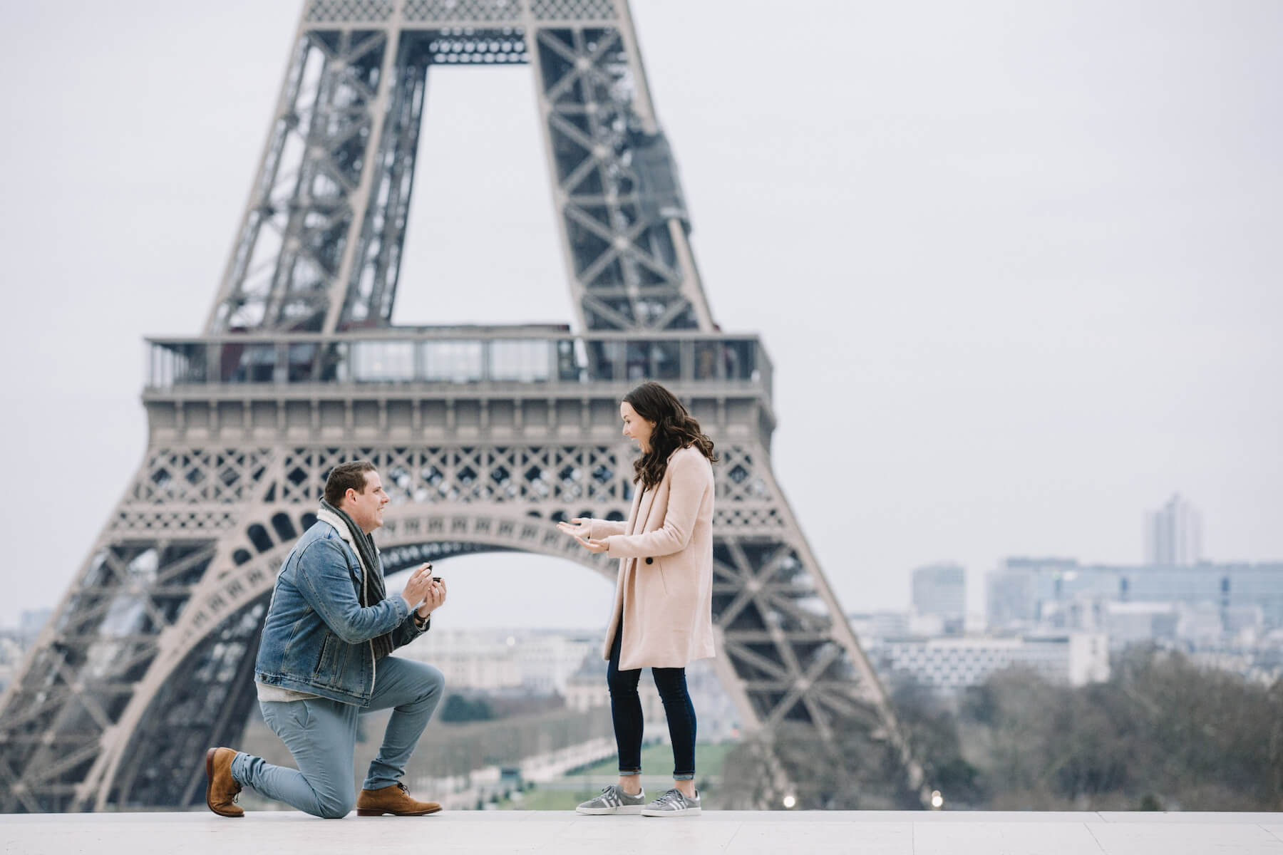 A woman being proposed to, in front of the Eiffel tower in Paris, France