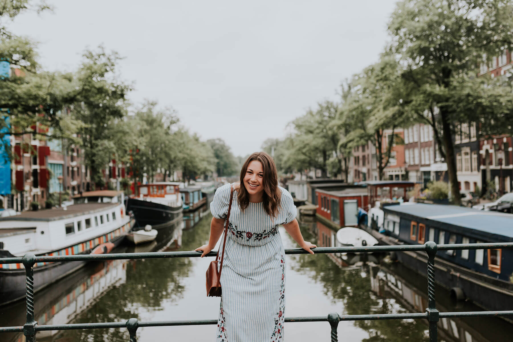 Solo woman traveler on a bridge in Amsterdam, Netherlands