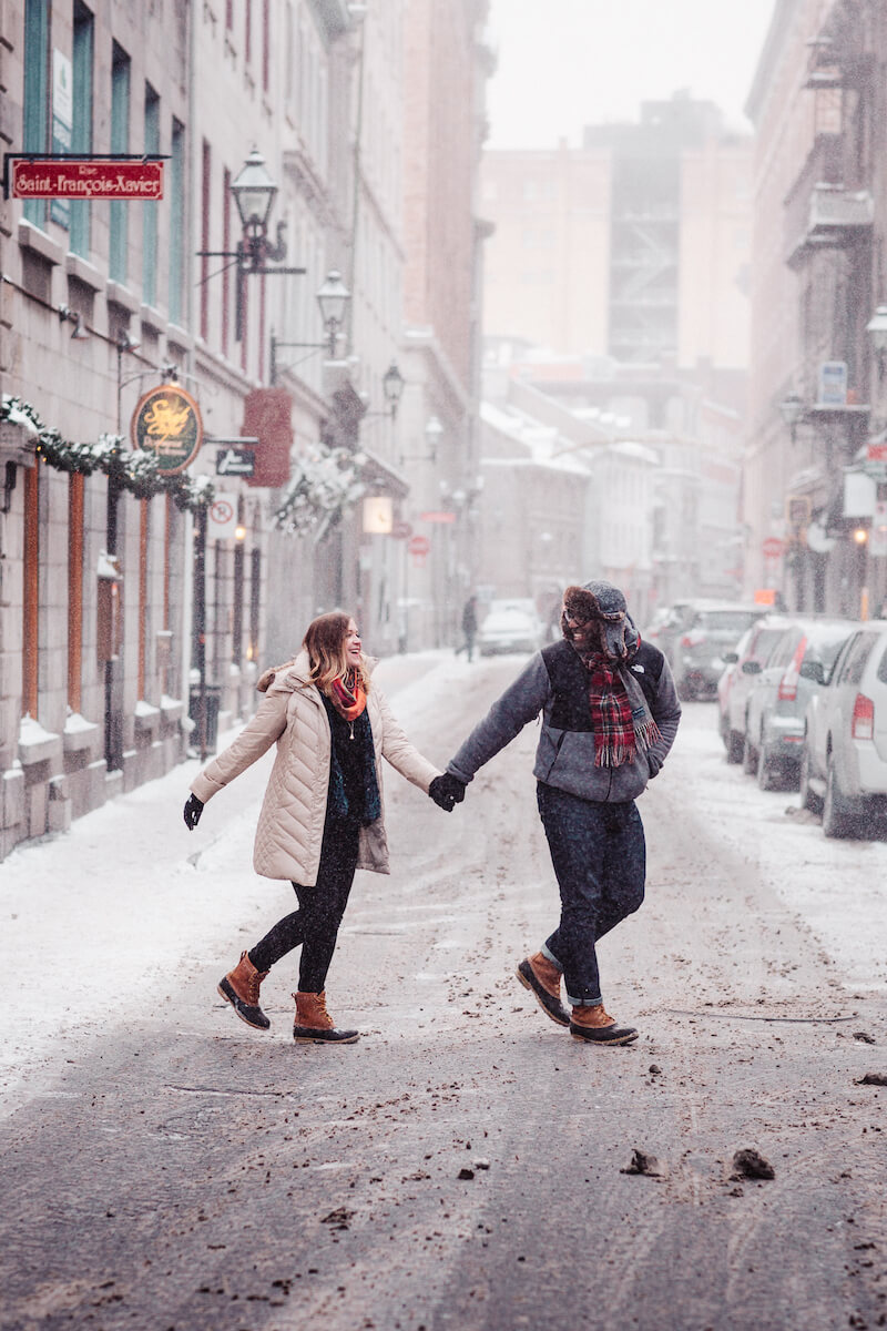 couple holding hands while crossing the street in Montreal, Quebec