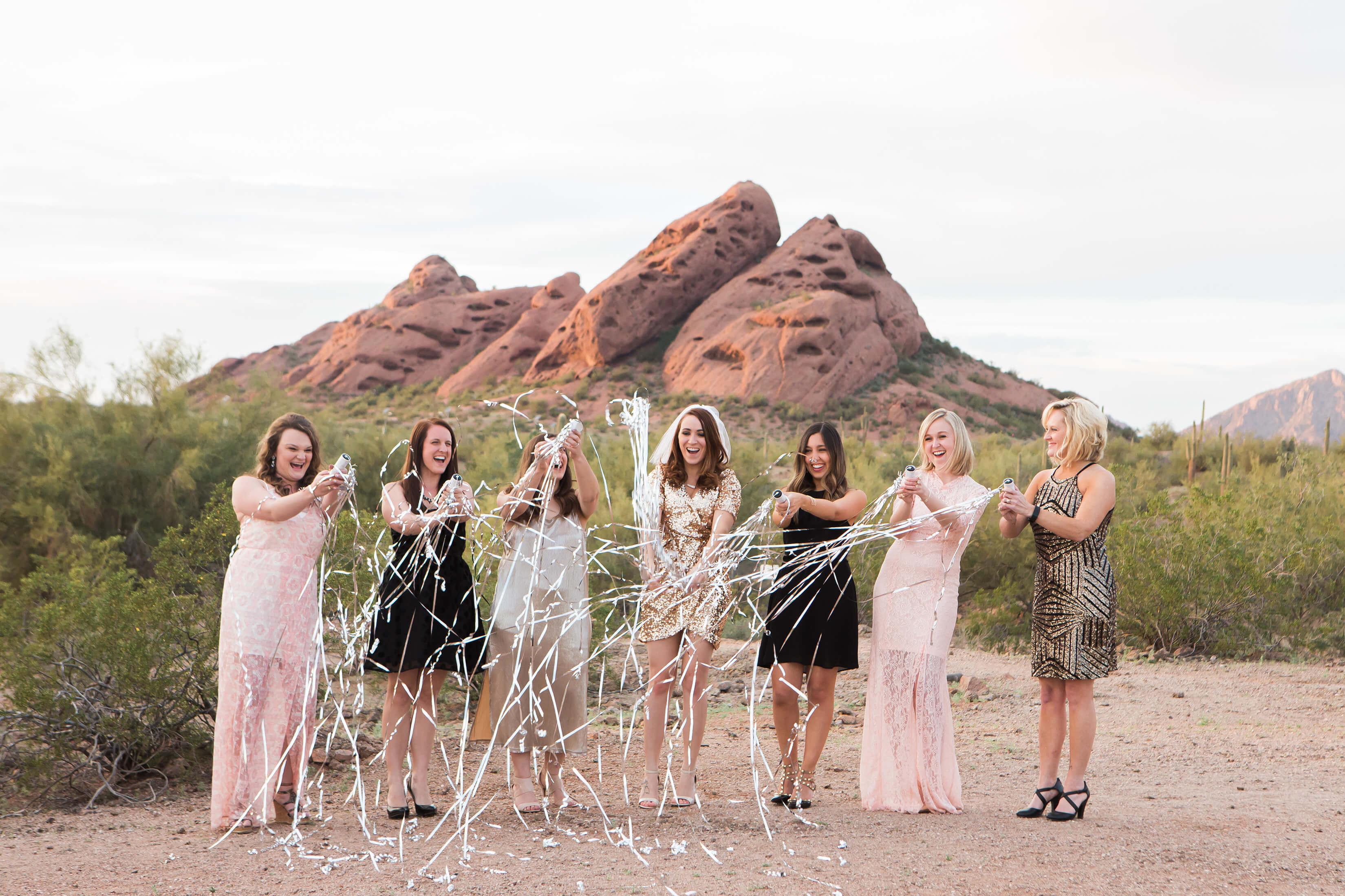 Bachelorette's opening a bottle of champagne in Scottsdale, Arizona