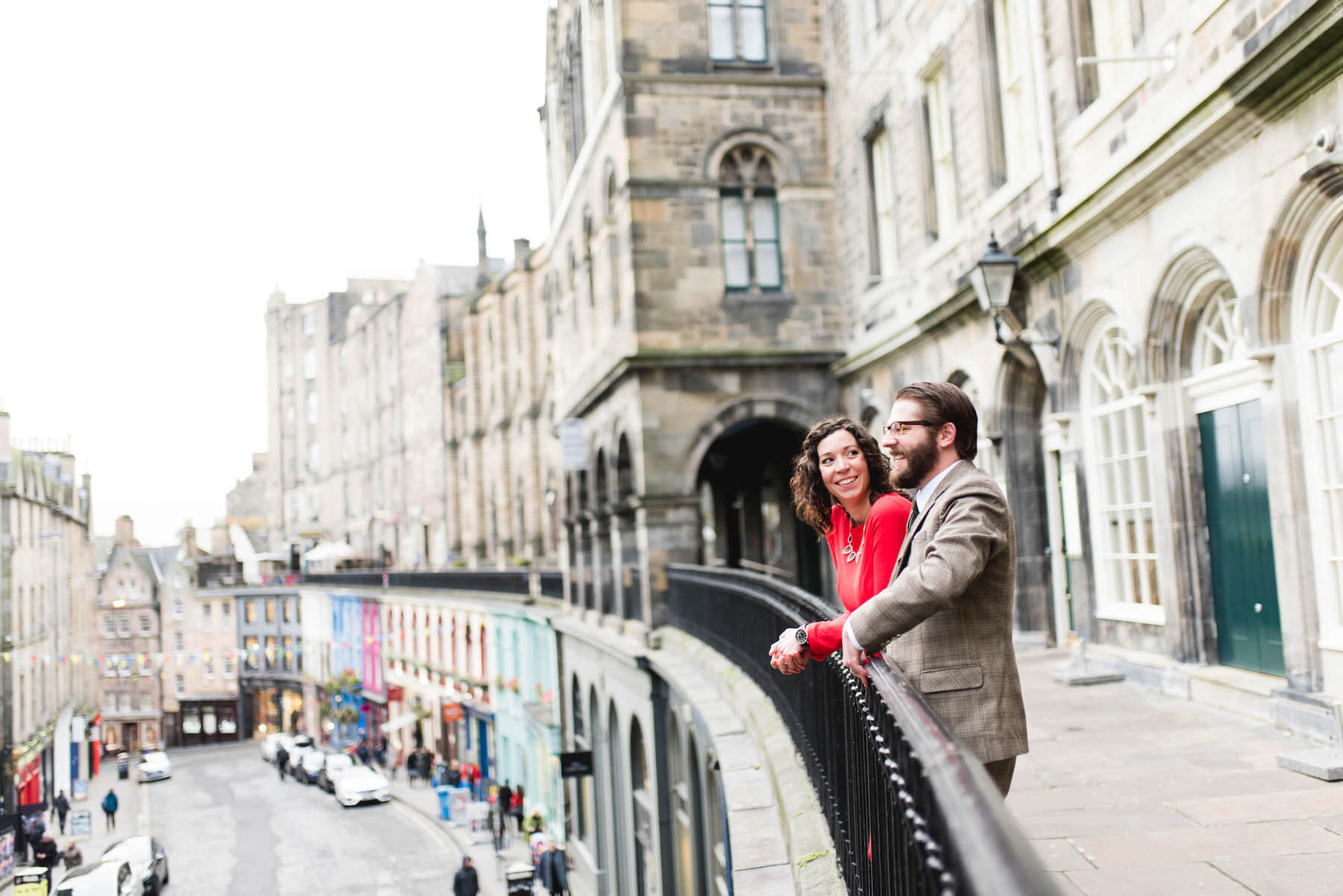 couple standing on a look point, looking at the city of Edinburgh, Scotland