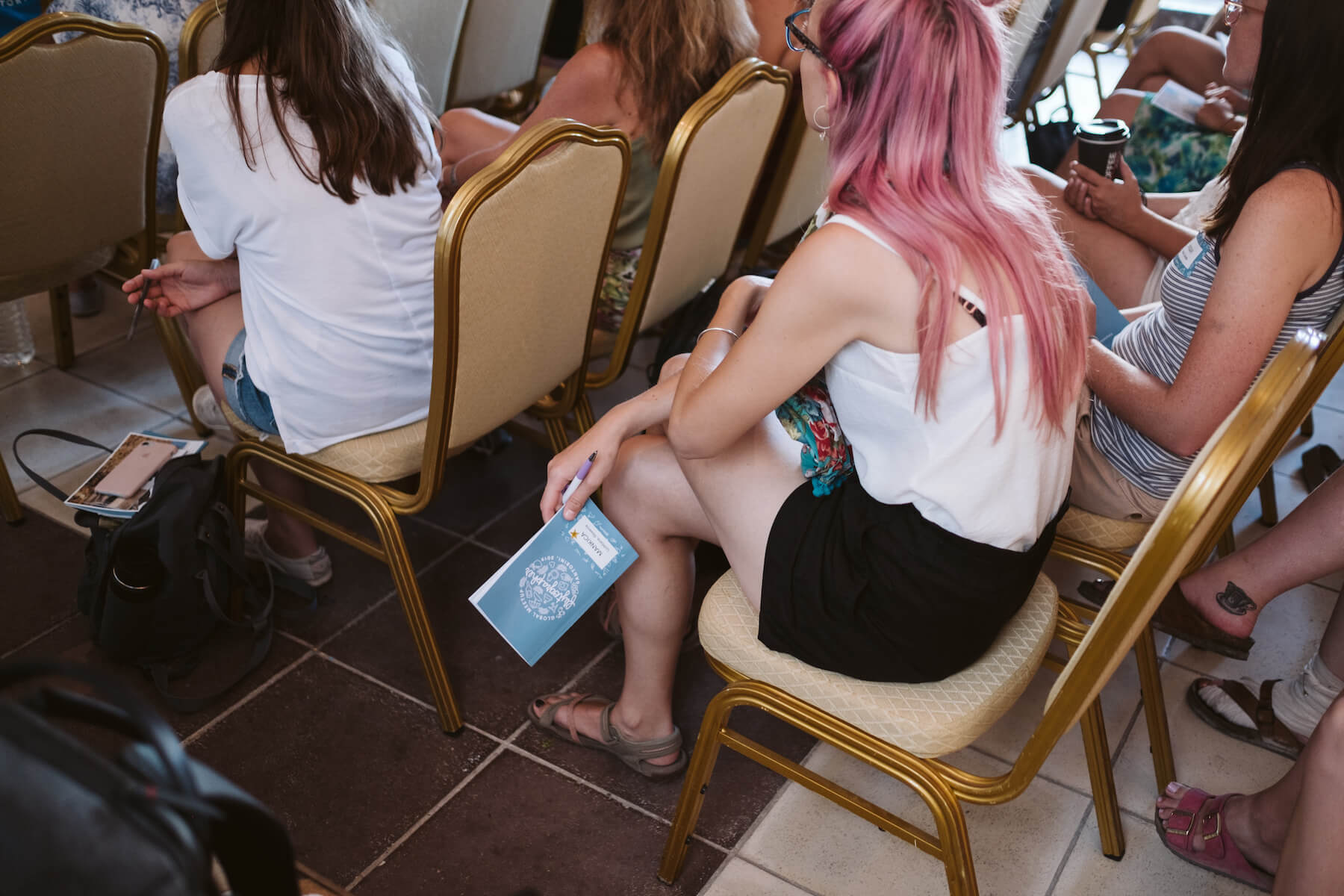 People listening in a conference room in Santorini, Greece