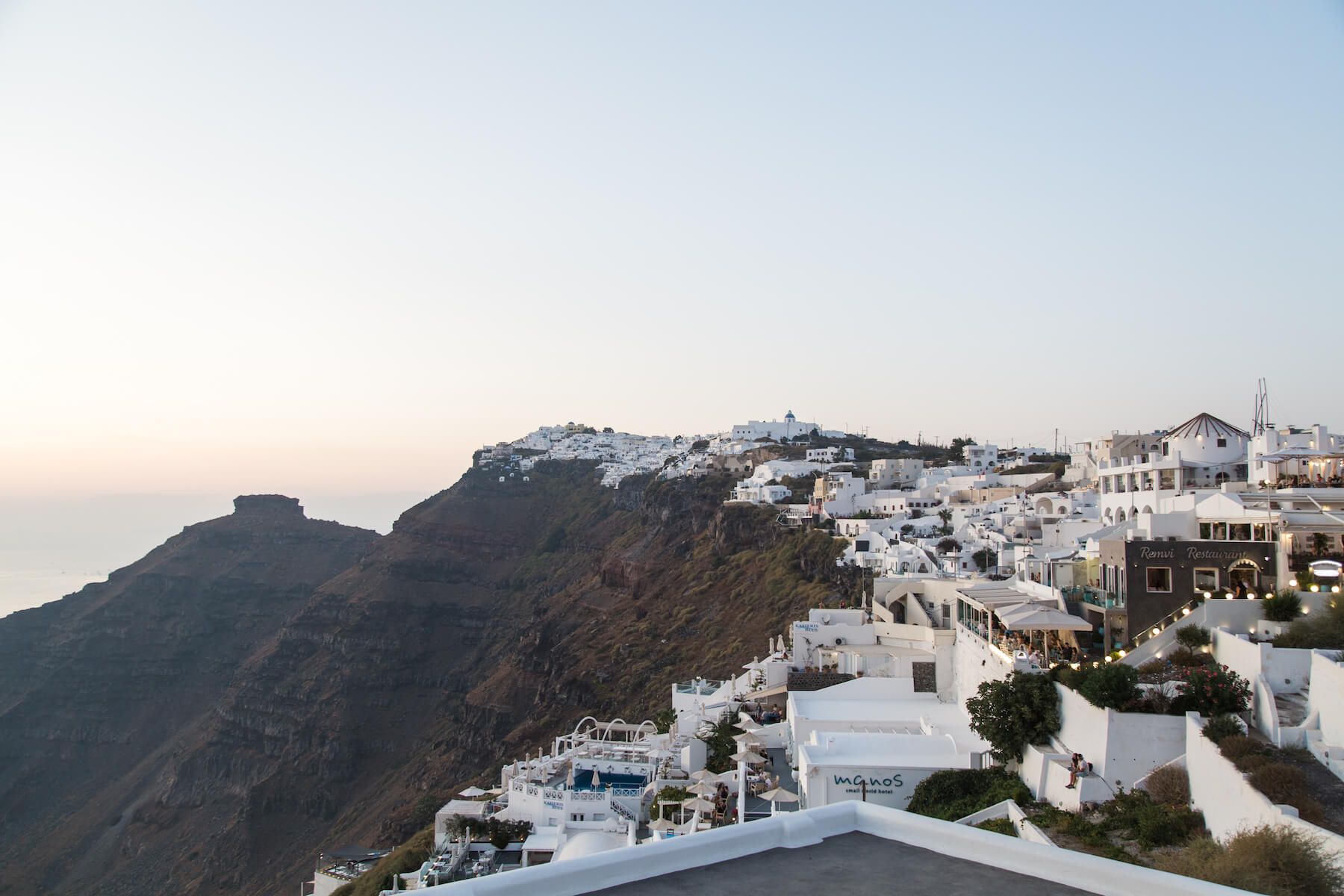 View of houses on a cliff in Santorini, Greece