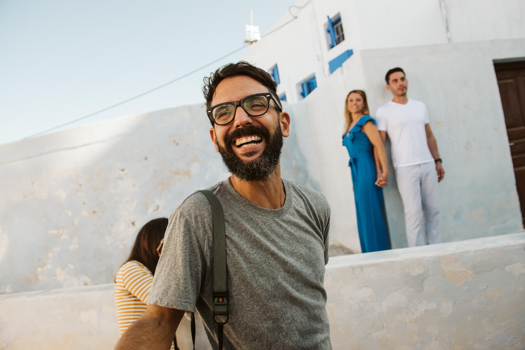 A man smiling in Santorini, Greece
