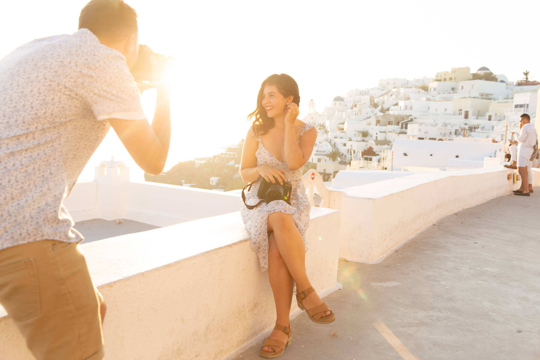 Photographer shooting a model in Santorini, Greece