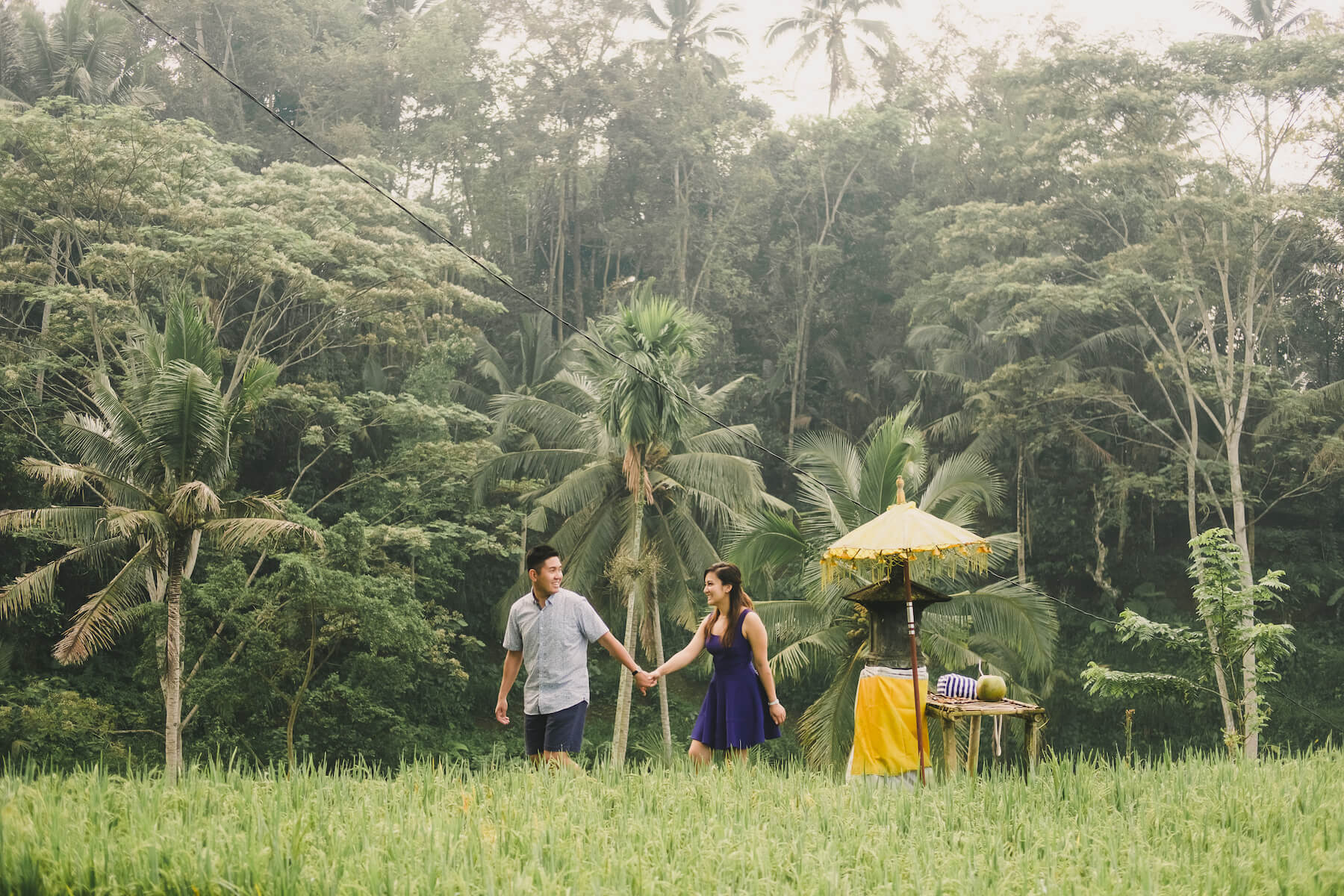 couple holding hands and walking through the jungle in Bali, Indonesia