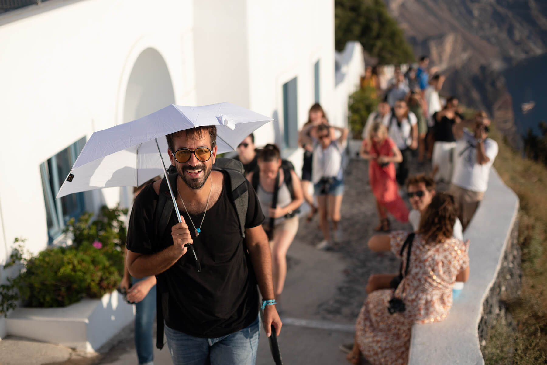 People hiking on a trail in Santorini, Greece