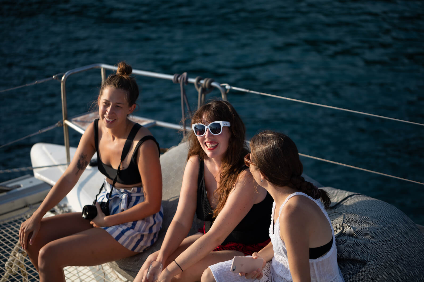 Women talking on a boat in Santorini, Greece
