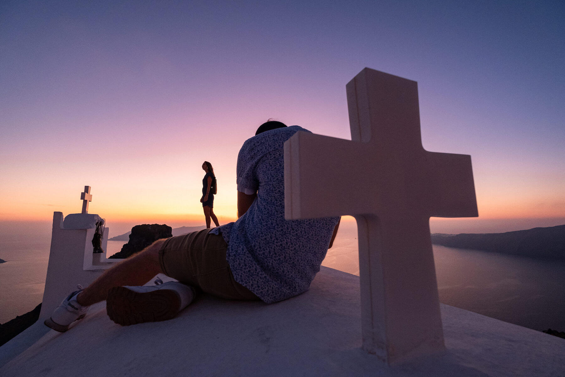 Photographers shooting models during sunset in Santorini, Greece