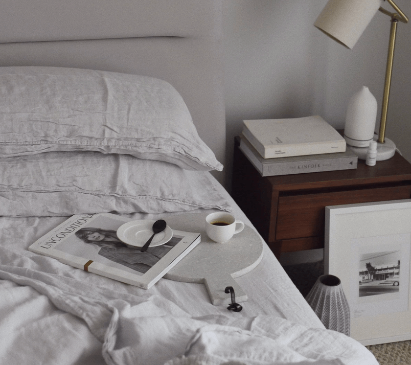 image of a bed made with Brooklinen's Linen Core Sheet Set