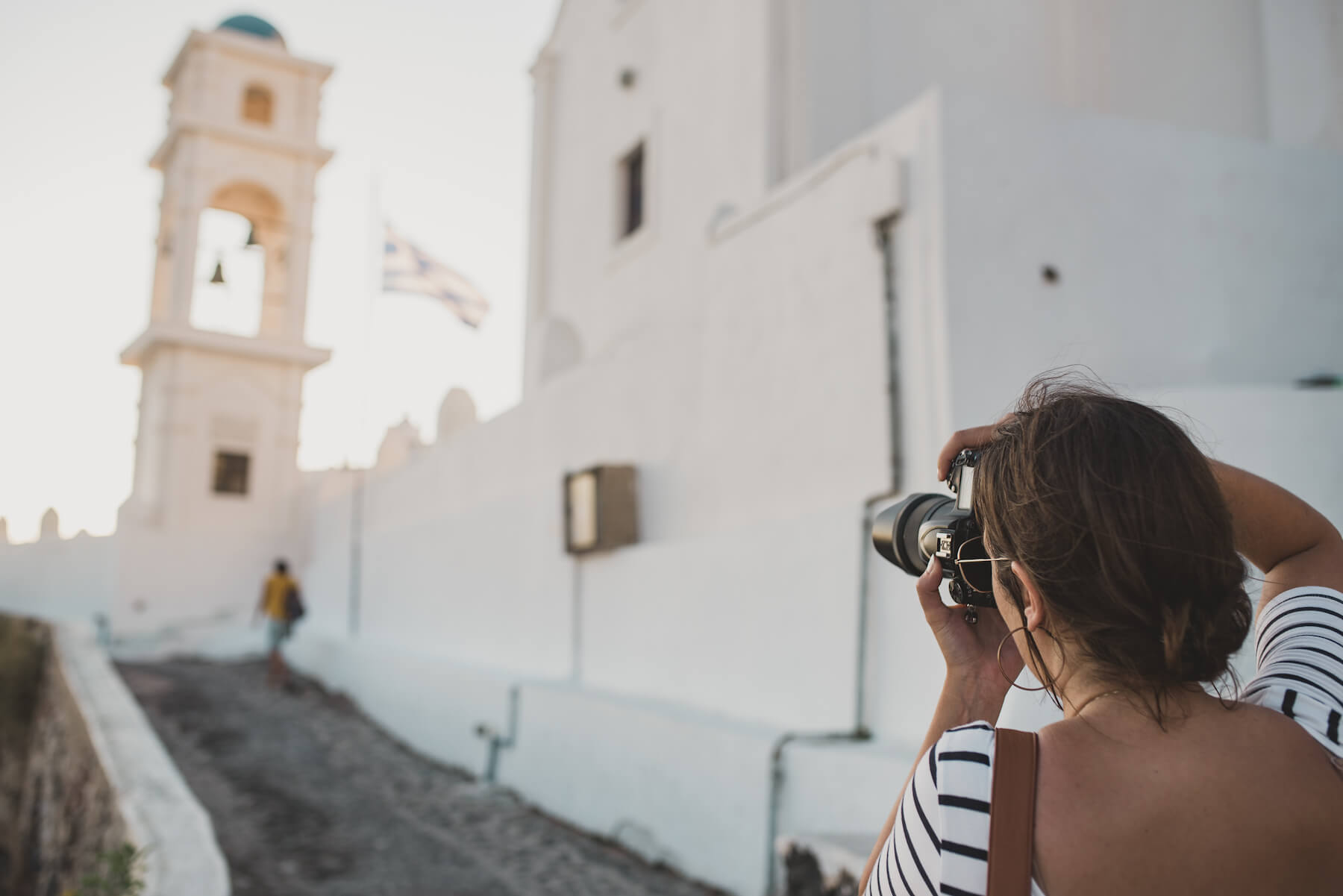 Photographer shooting a scene in Santorini, Greece