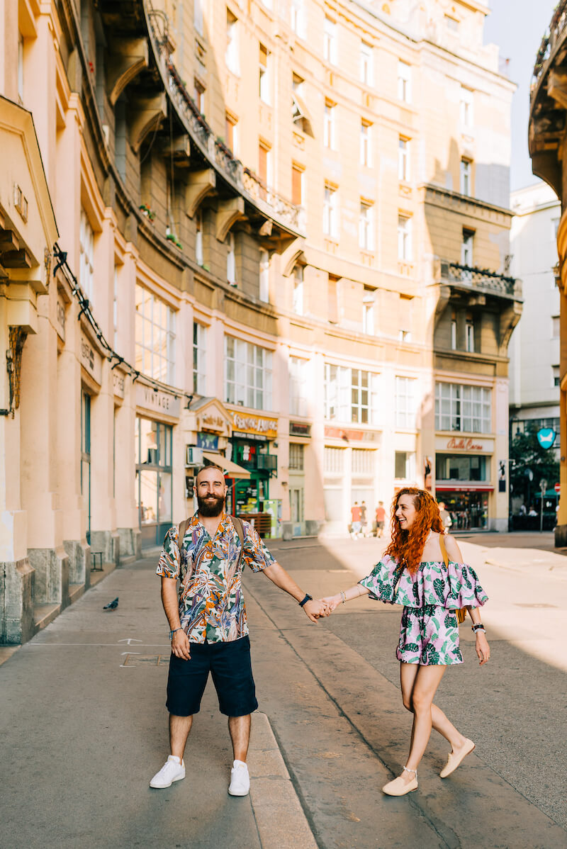 couple having fun walking across a street in Budapest, Hungary