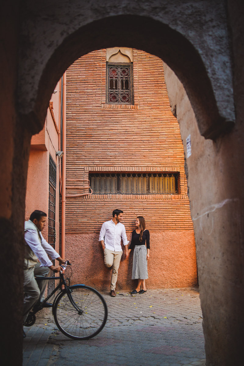 Couple leaning against a wall in Marrakesh, Morocco