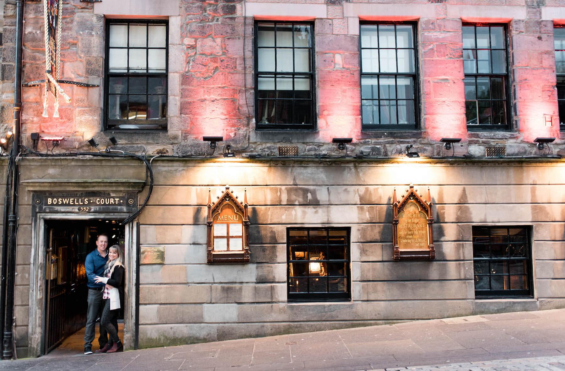 couple standing in the doorway of a pub in Edinburgh, Scottland