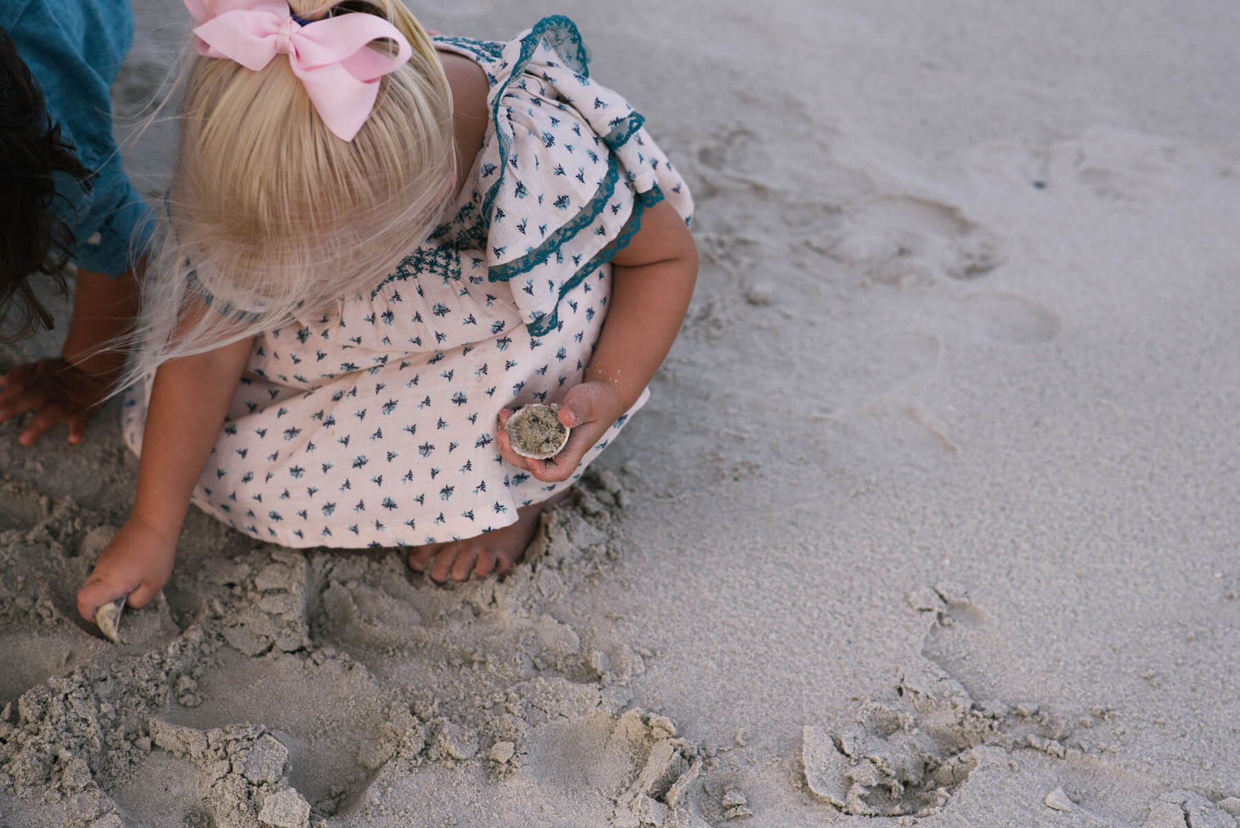 a closeup of a little girl on the beach in Savannah, Georgia, United States of America
