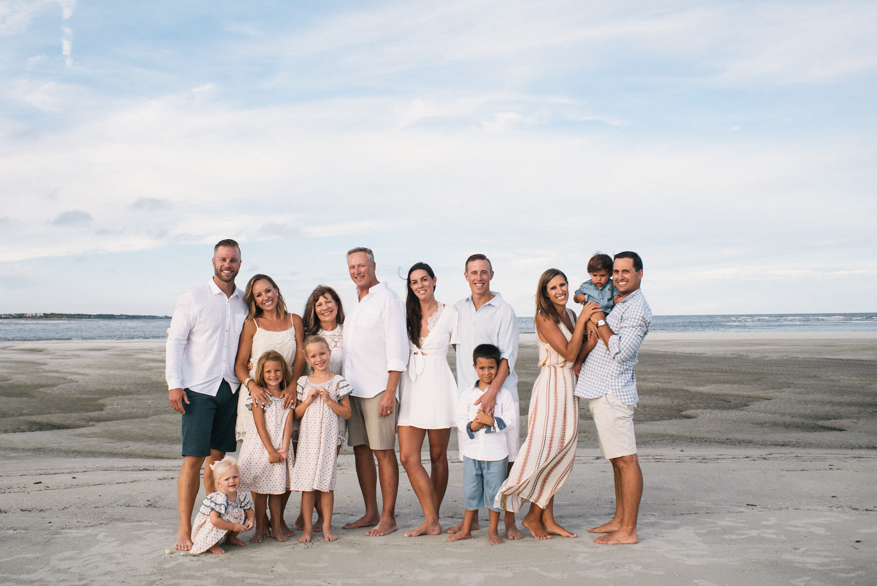 a multigenerational family standing on the beach Savannah, Georgia, United States of America