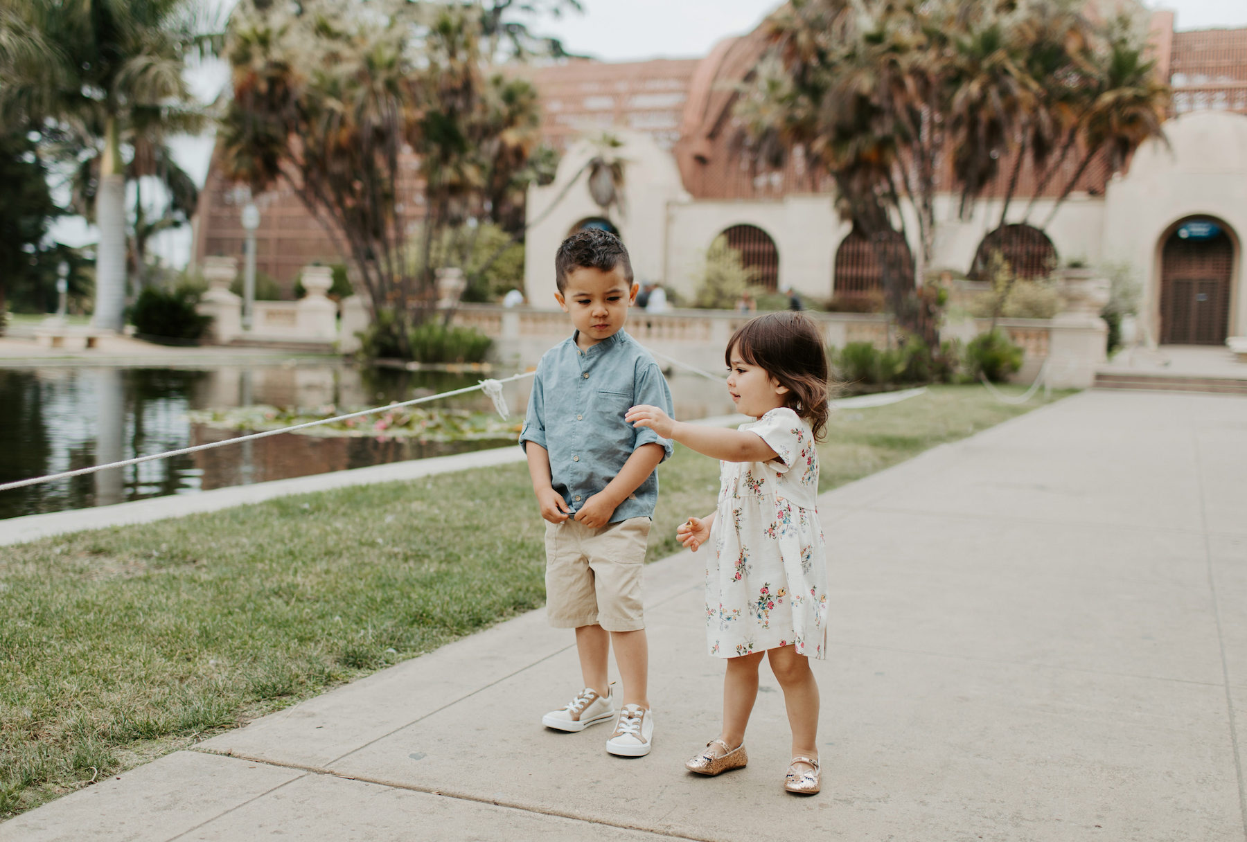 two young children standing in Balboa Park in San Diego, California
