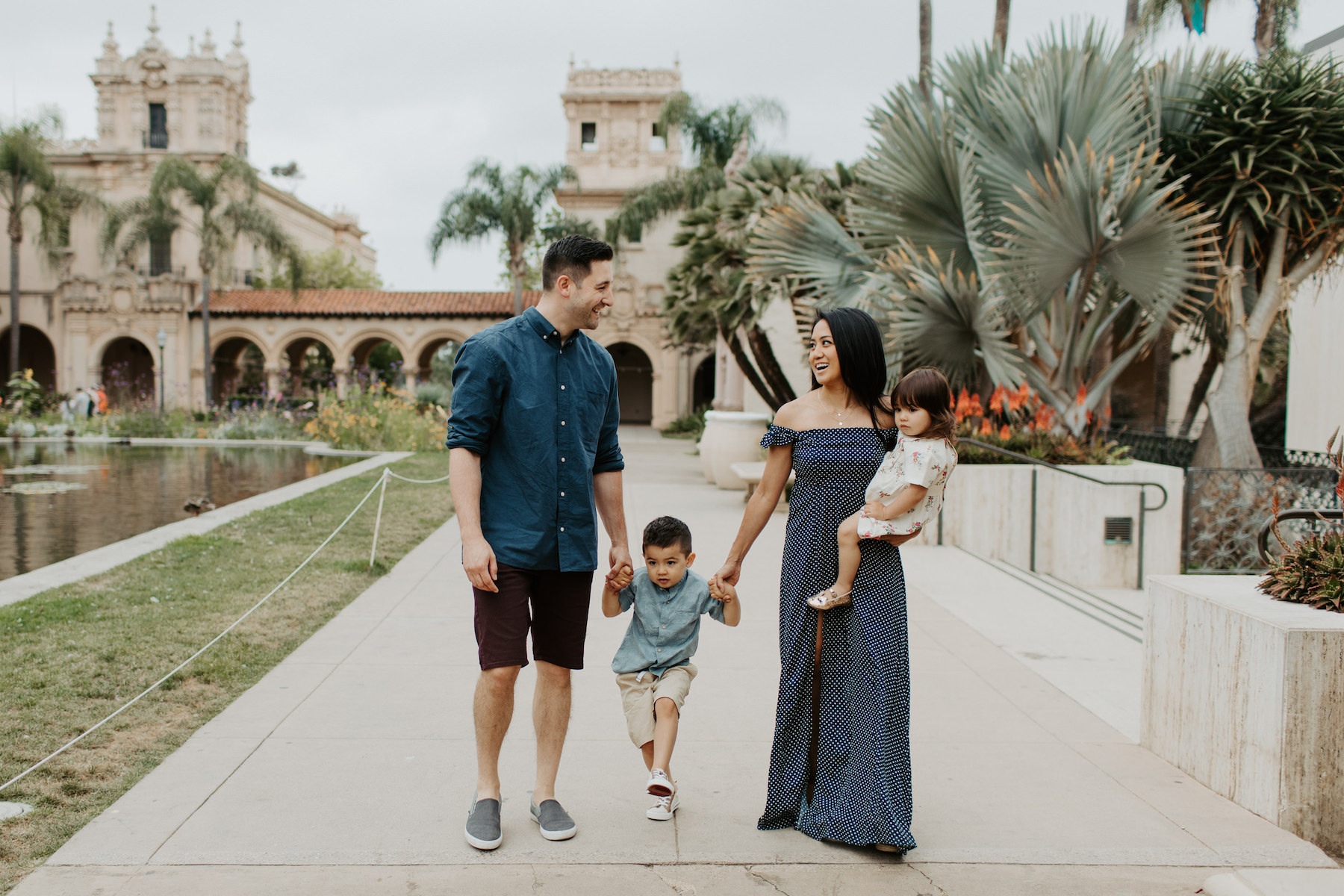 a family with two kids walking in Balboa Park San Diego, California