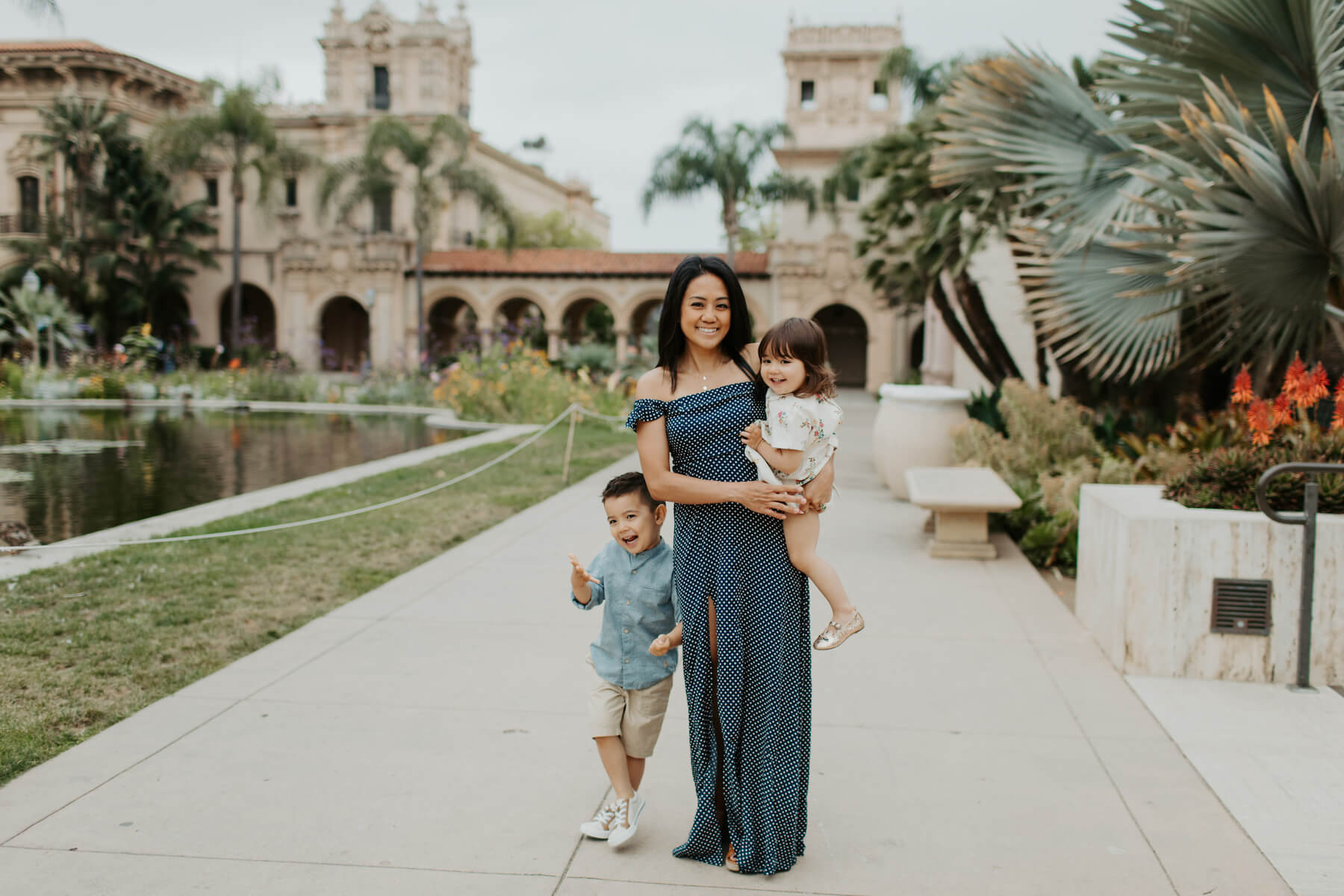 mother with her two children walking in Balboa Park San Diego, California