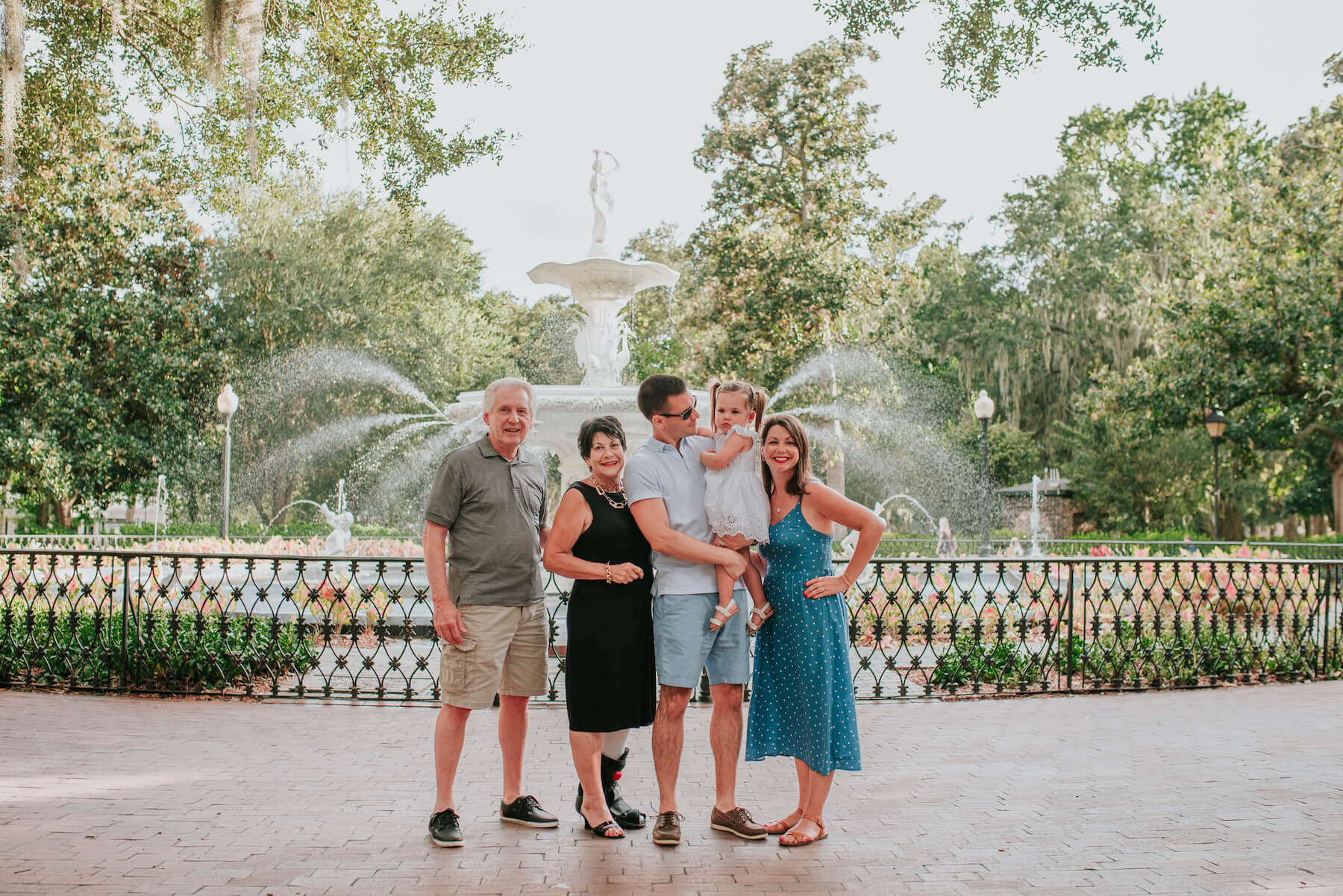 multigenerational family standing in front of the fountain in Savannah, Georgia, United States of America