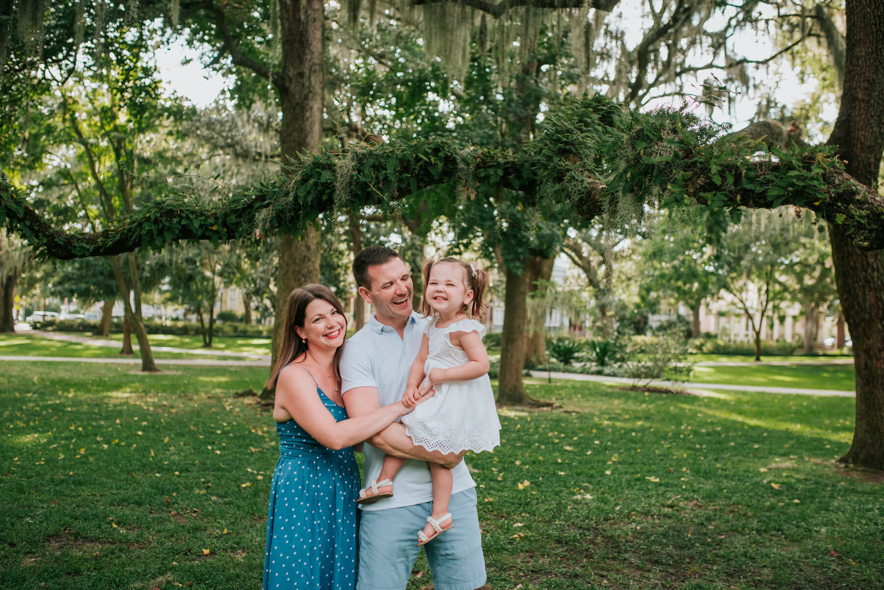 a family of three in a park in Savannah, Georgia, United States of America