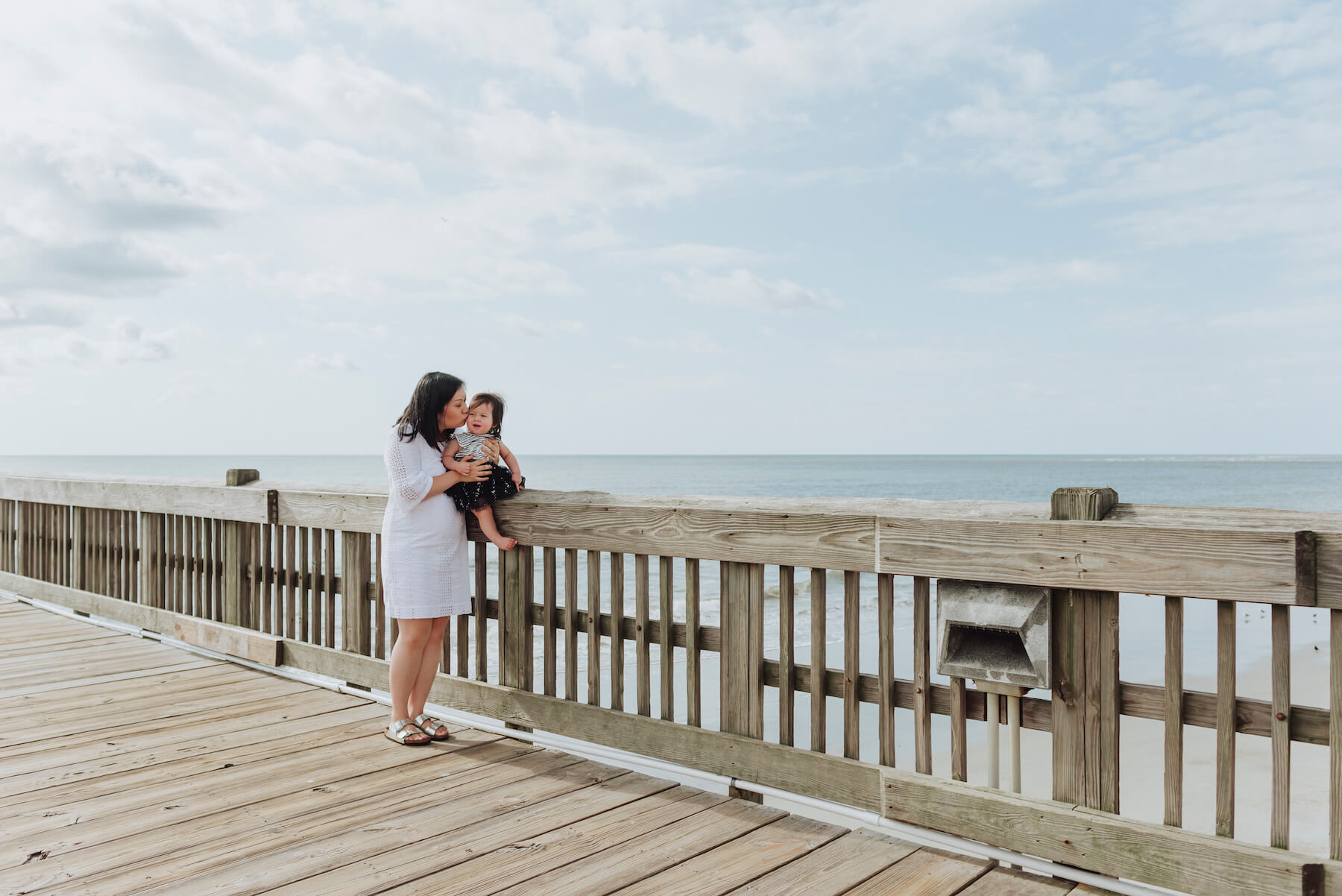 mother and infant daughter on a pier in Savannah, Georgia, United States of America