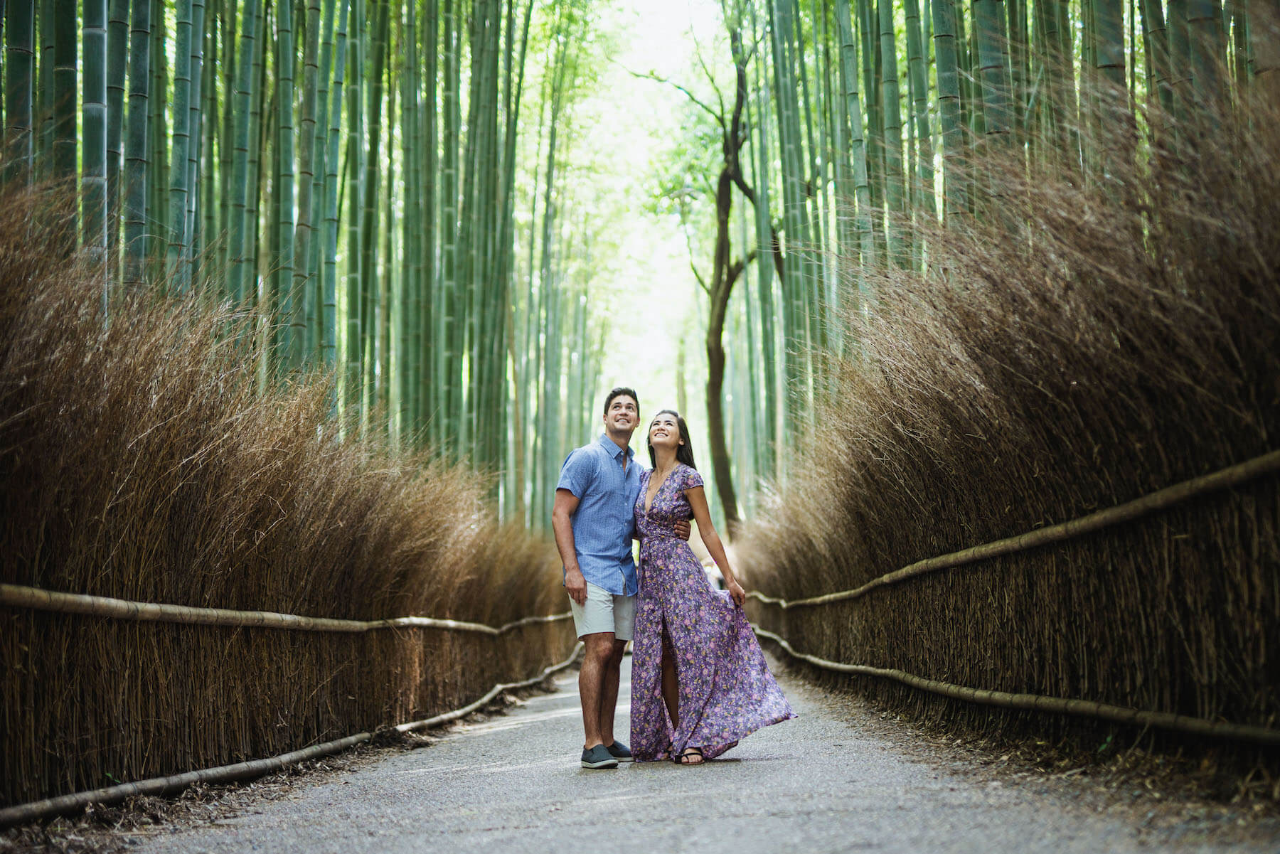 couple walking in bamboo forest in Kyoto, Japan