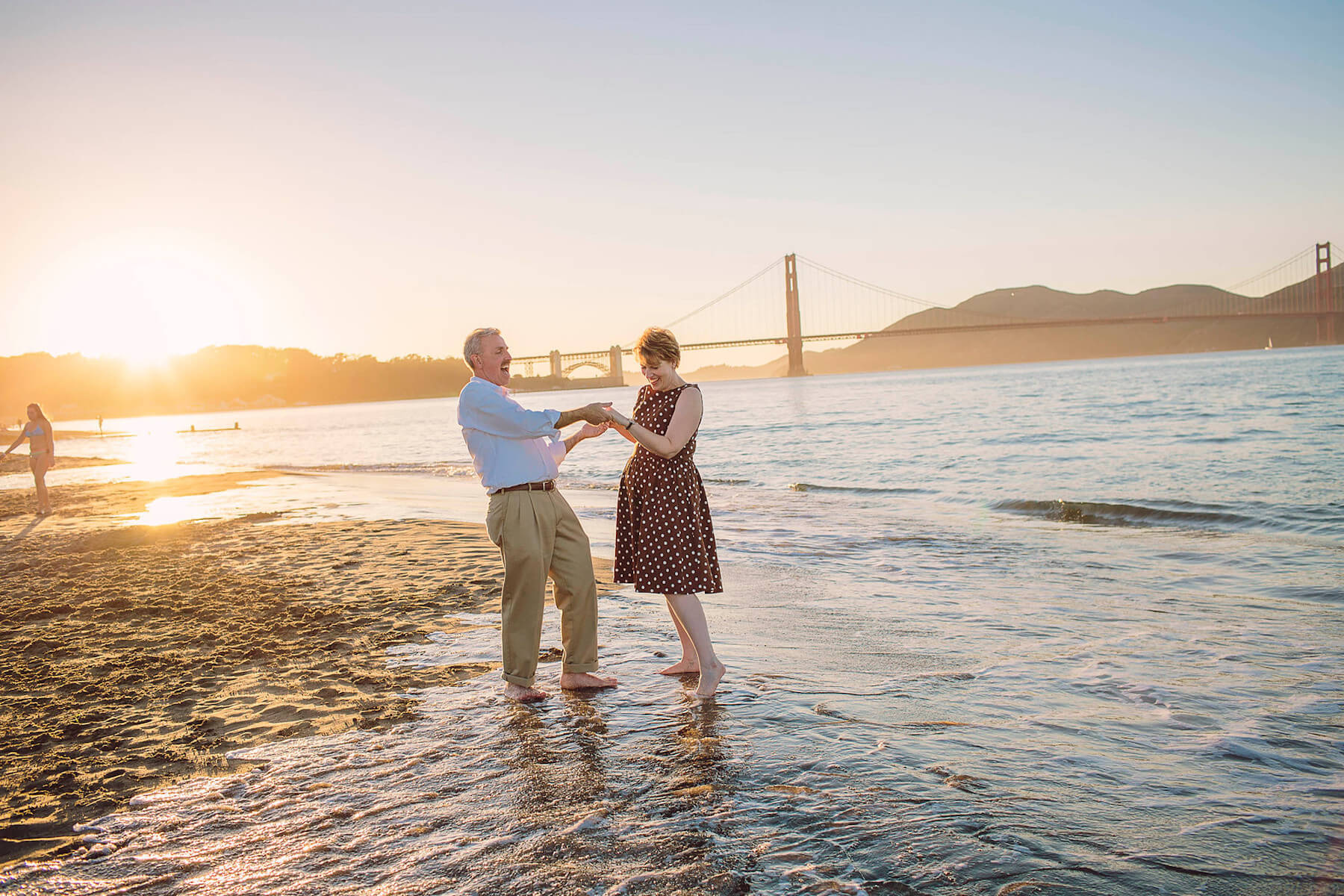 older couple dancing on the beach in San Francisco, California