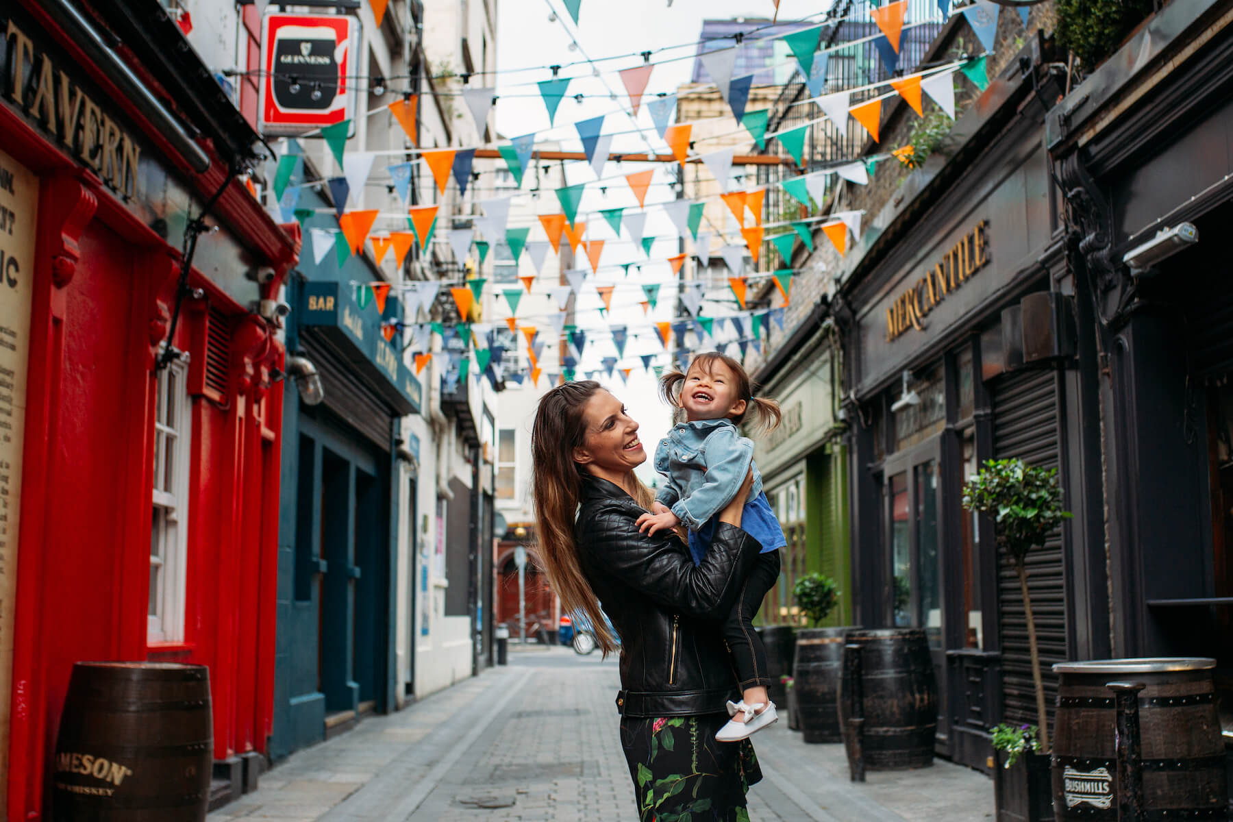 a mother and daughter standing on a colorful street in Dublin, Ireland