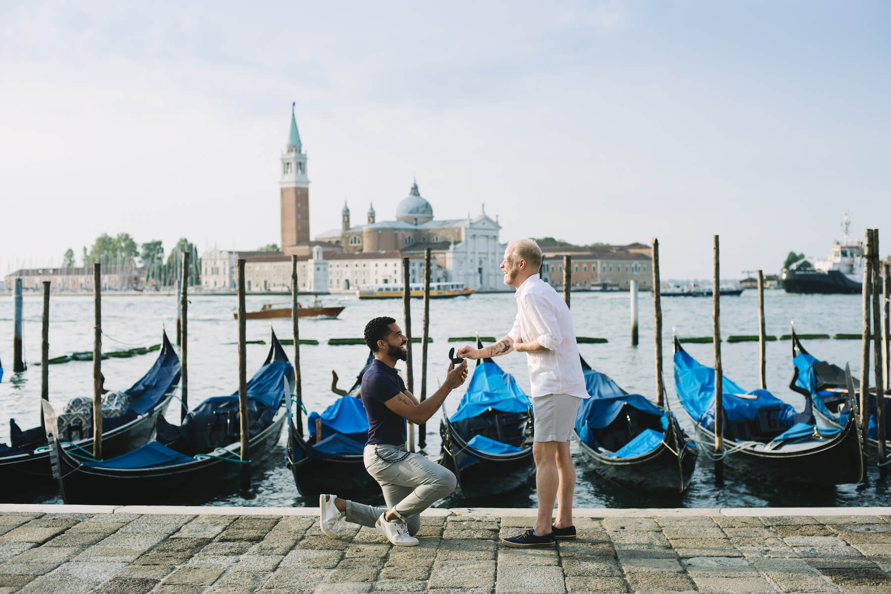 LGBTQ couple, and one man is proposing to the other in Venice, Italy