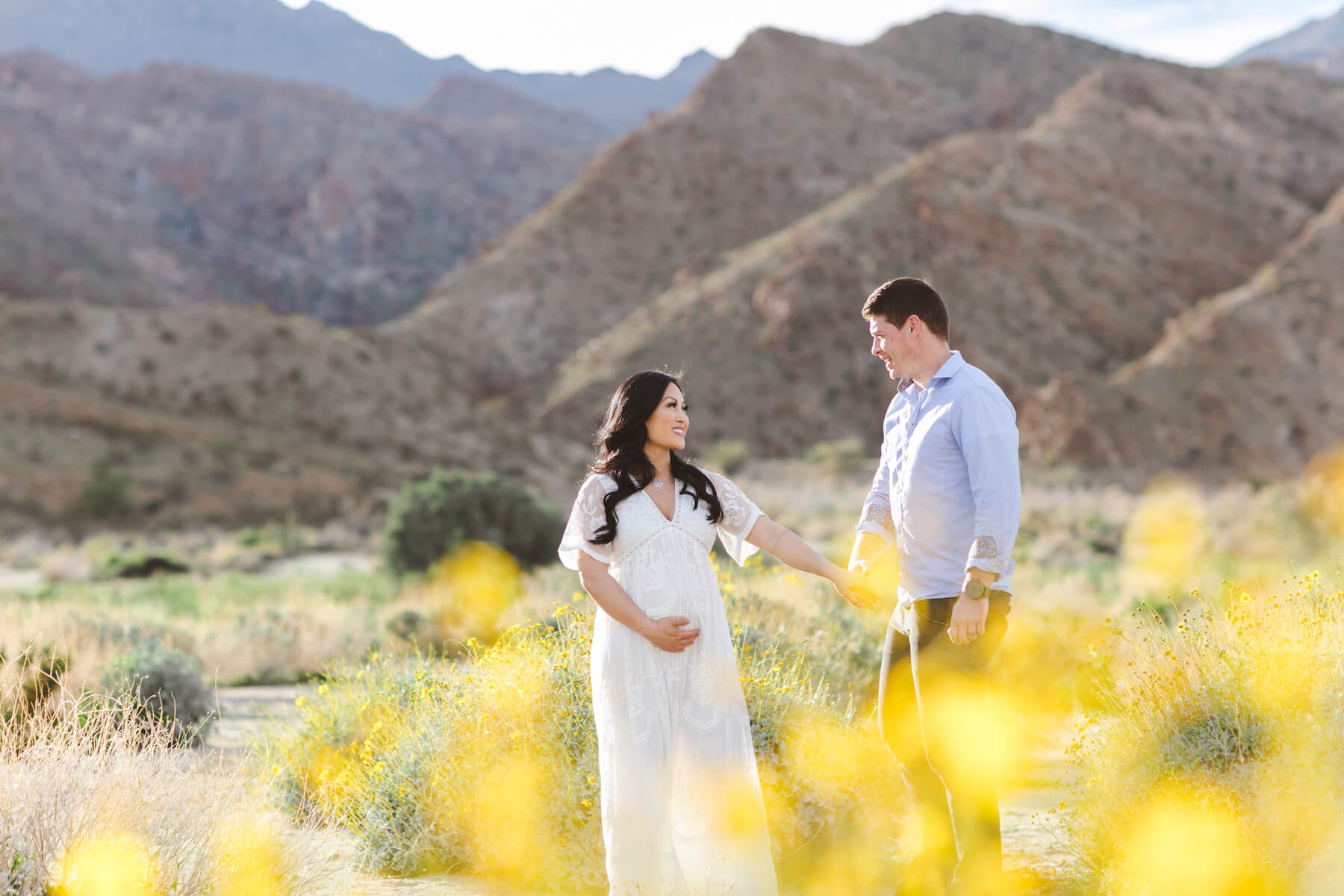 couple standing and holding each other in the desert in Palm Springs, California