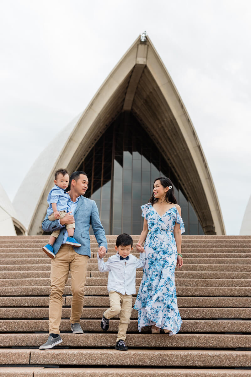family walking down the stair by the Opera house in Sydney, Australia