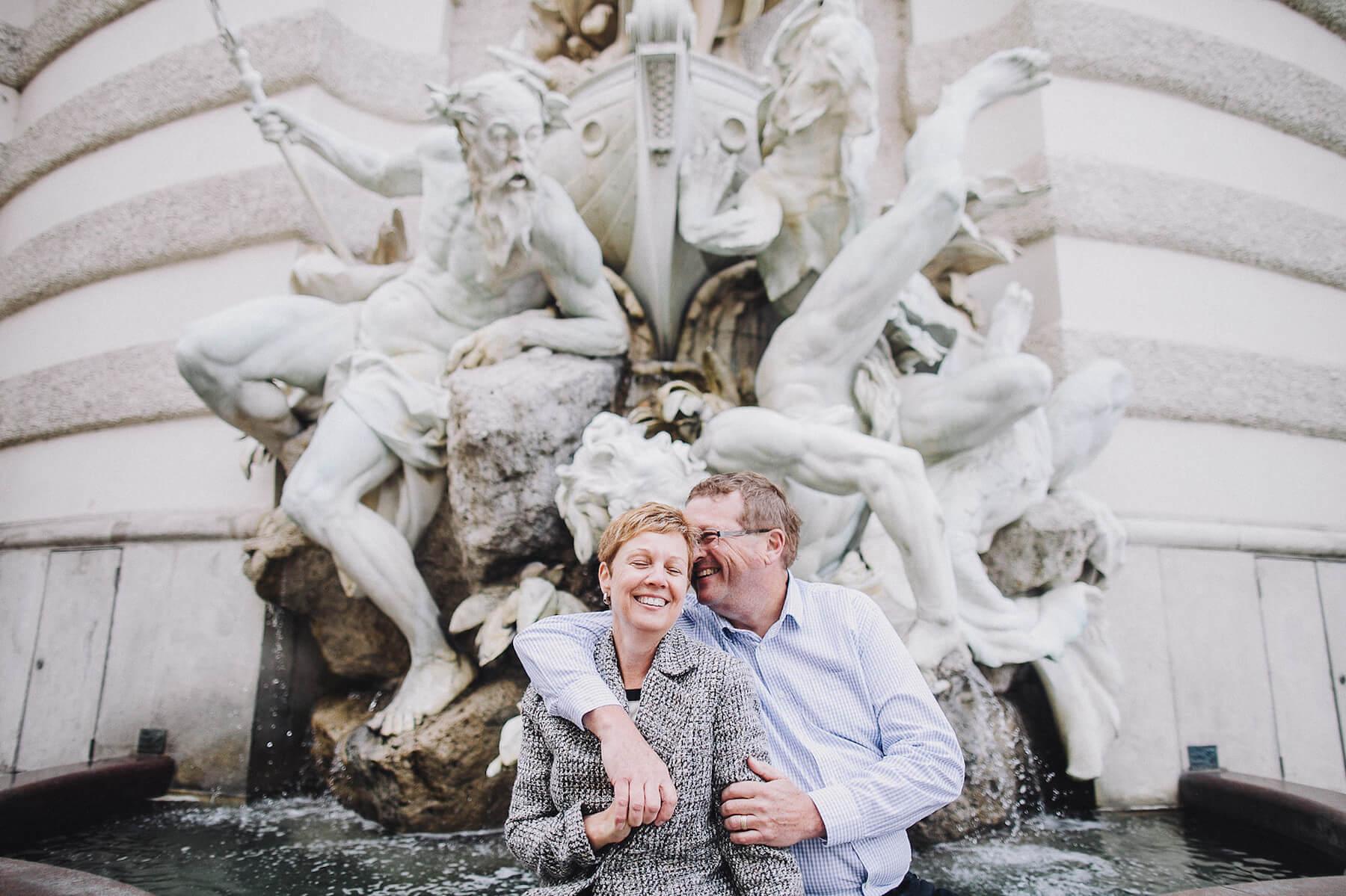 older couple sitting near a fountain in Vienna, Austria