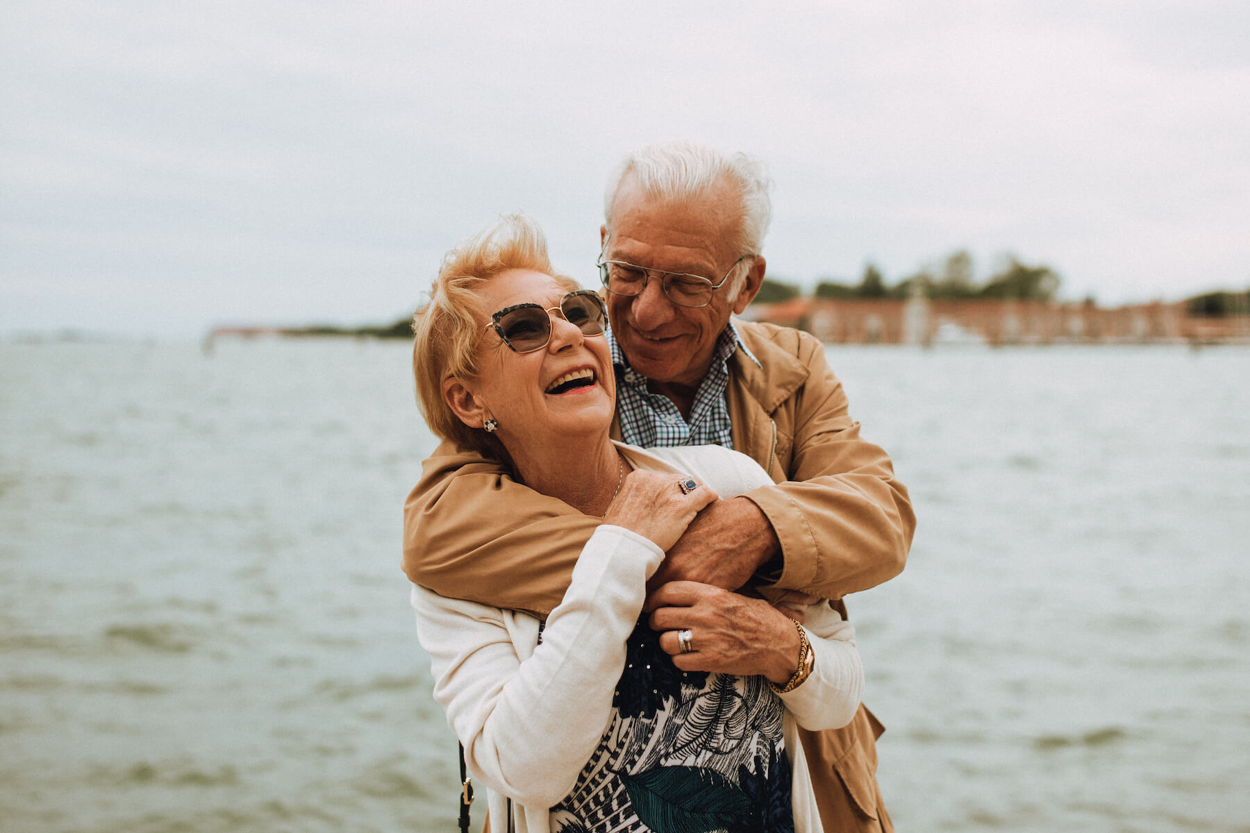 older couple hugging each other in Venice, Italy