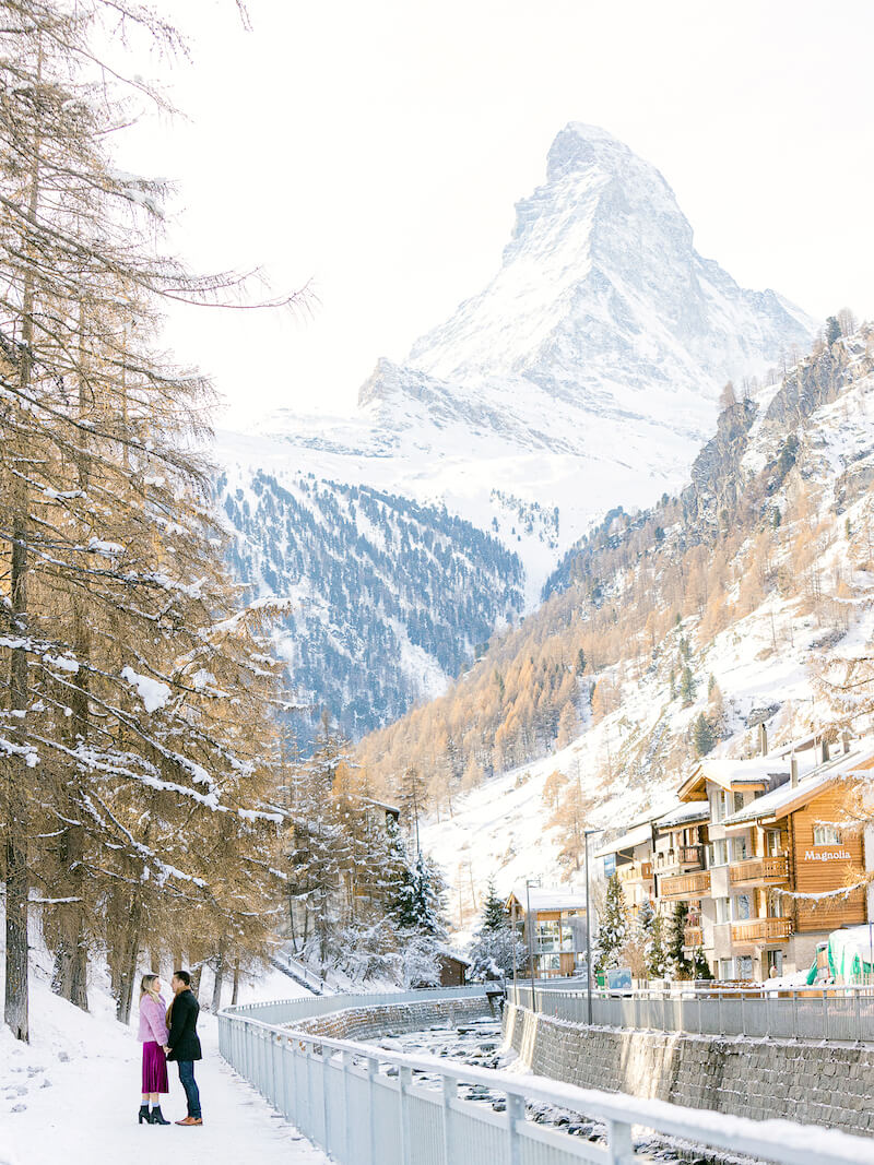 couple looking at each other and holding hands in a mountainside village in Zermatt, Switzerland