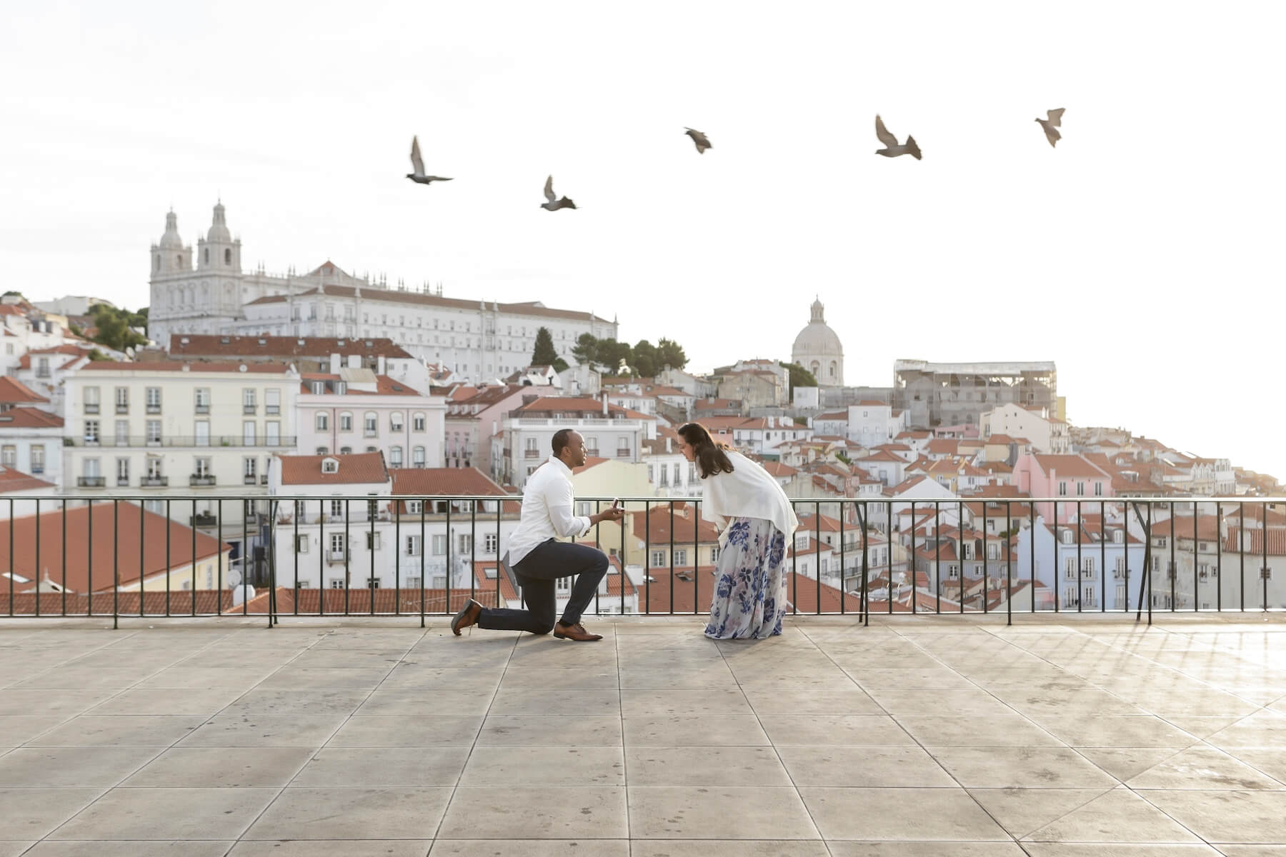 a man is proposing to a woman in Lisbon, Portugal