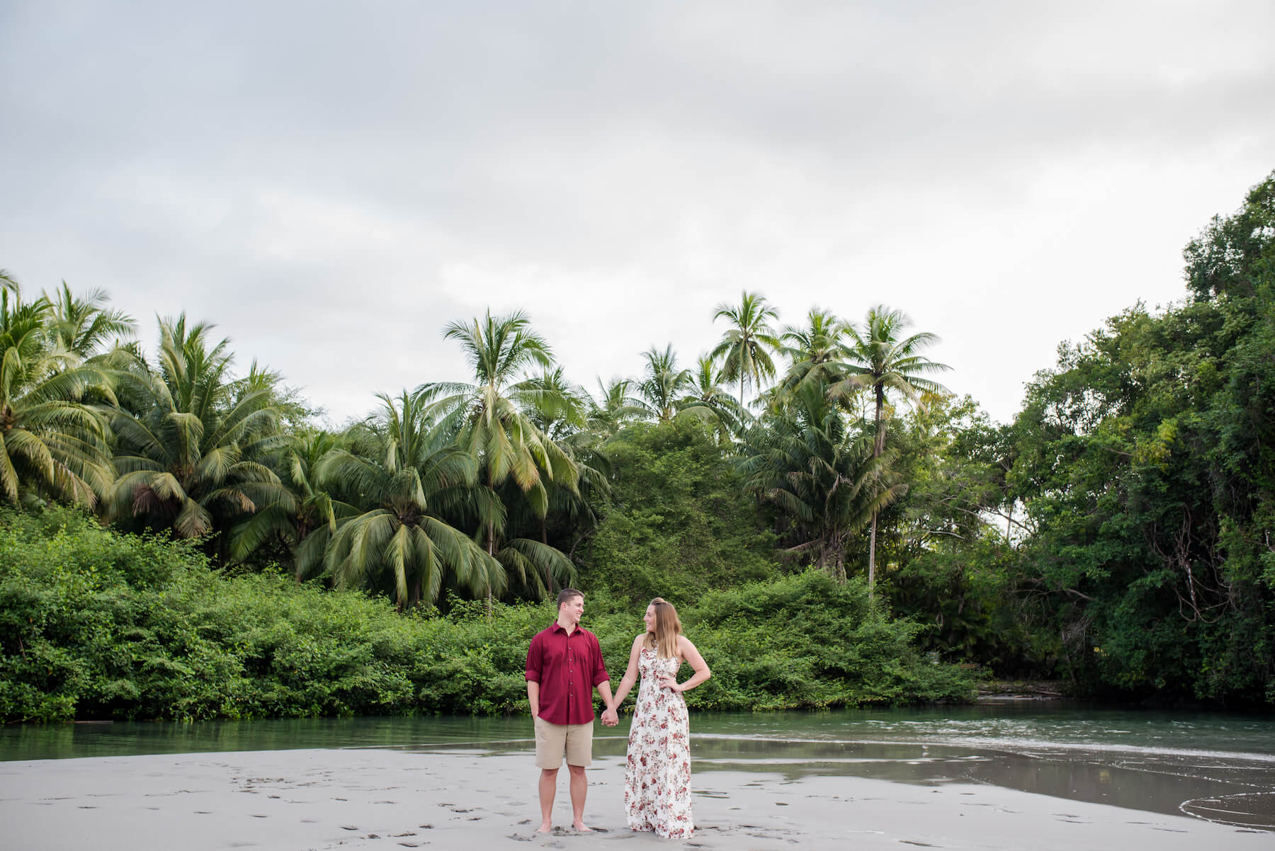 couple standing on the beach in Manuel Antonio, Costa Rica